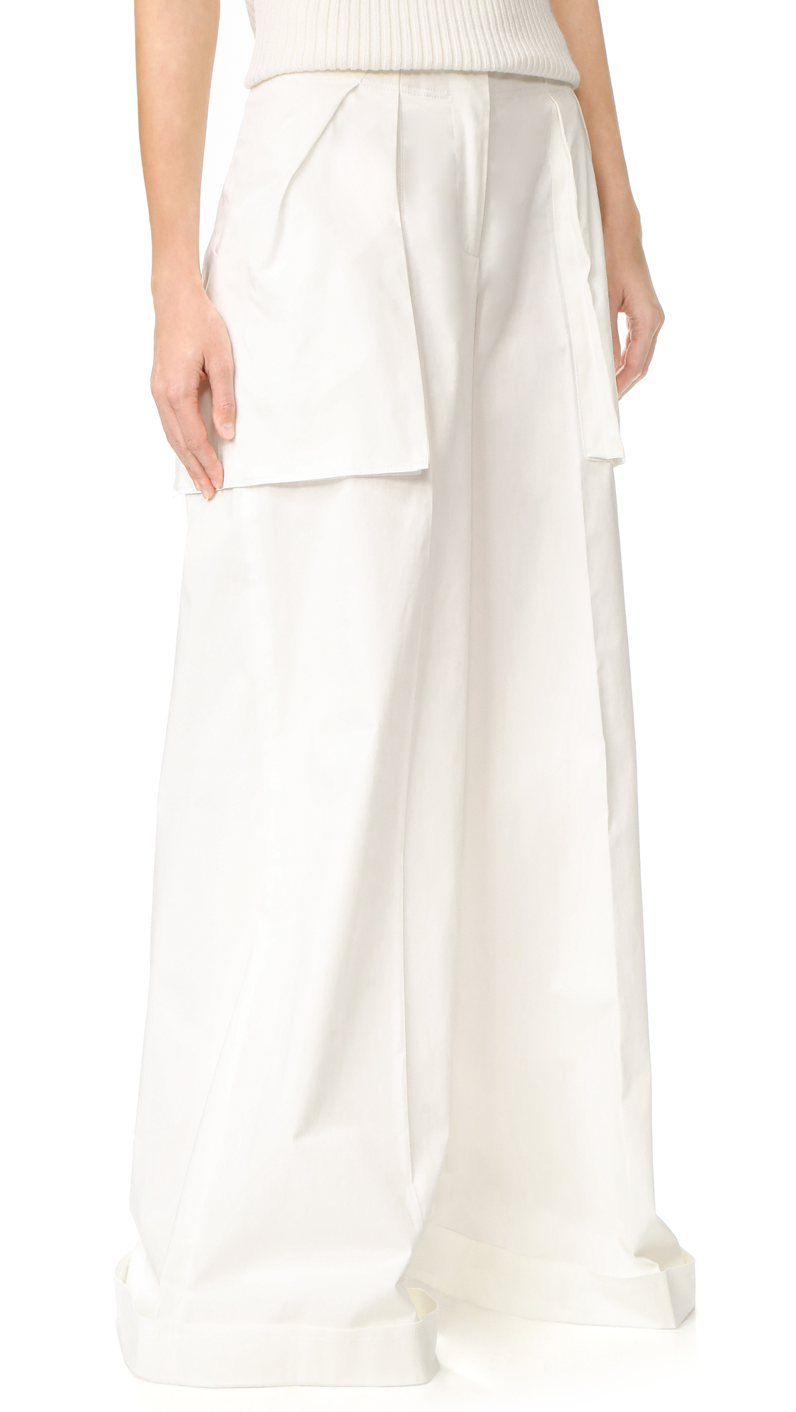 Crisp, high waisted Monse pants in a wide leg profile. Raised, oversized pockets. Cuffed hem. Hook and eye closure and zip fly. Fabric: Stretch weave. 97% cotton/3% elastane. Dry clean. Made in Italy. Measurements Rise: 11.75in / 30cm