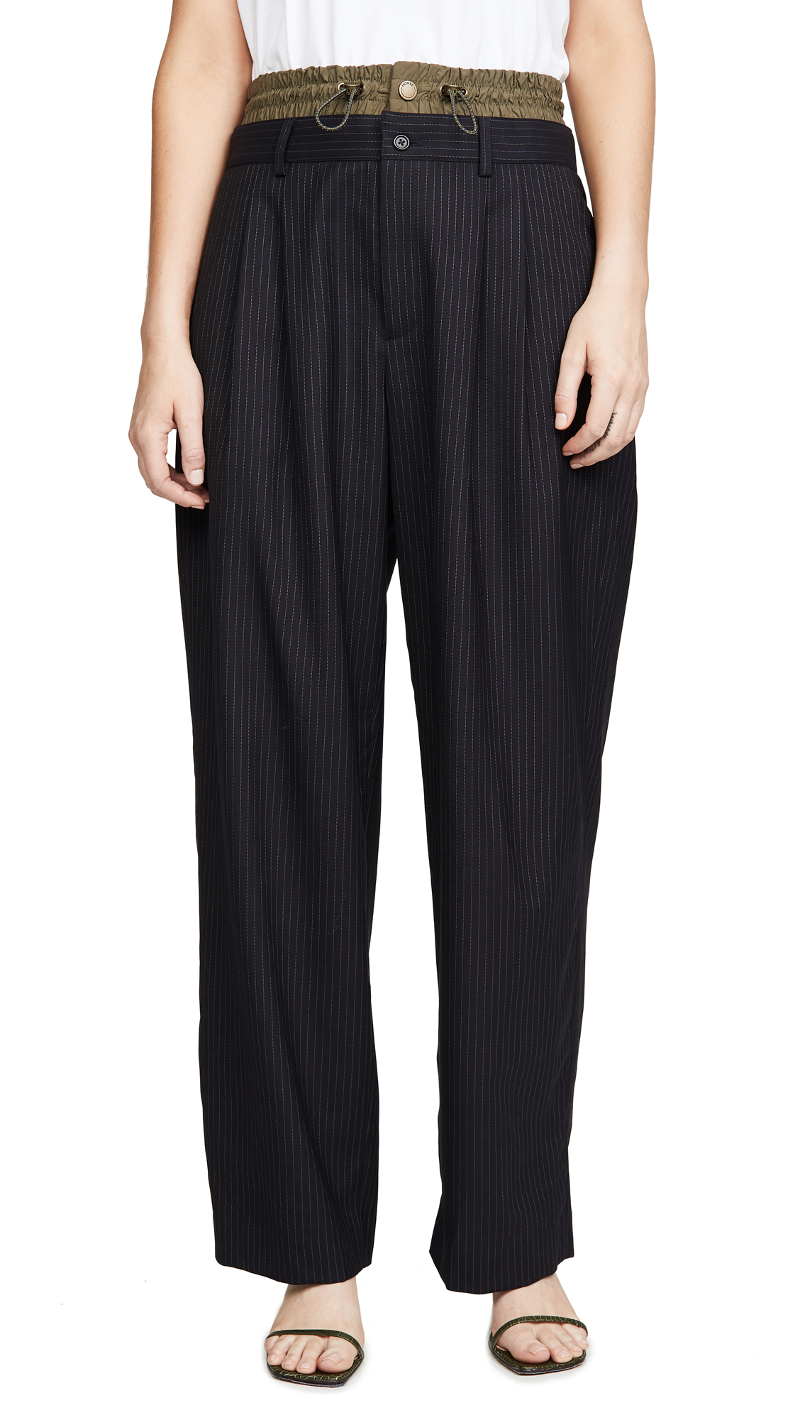 Buy Monse online - photo of Monse Pinstripe Pleated Trousers