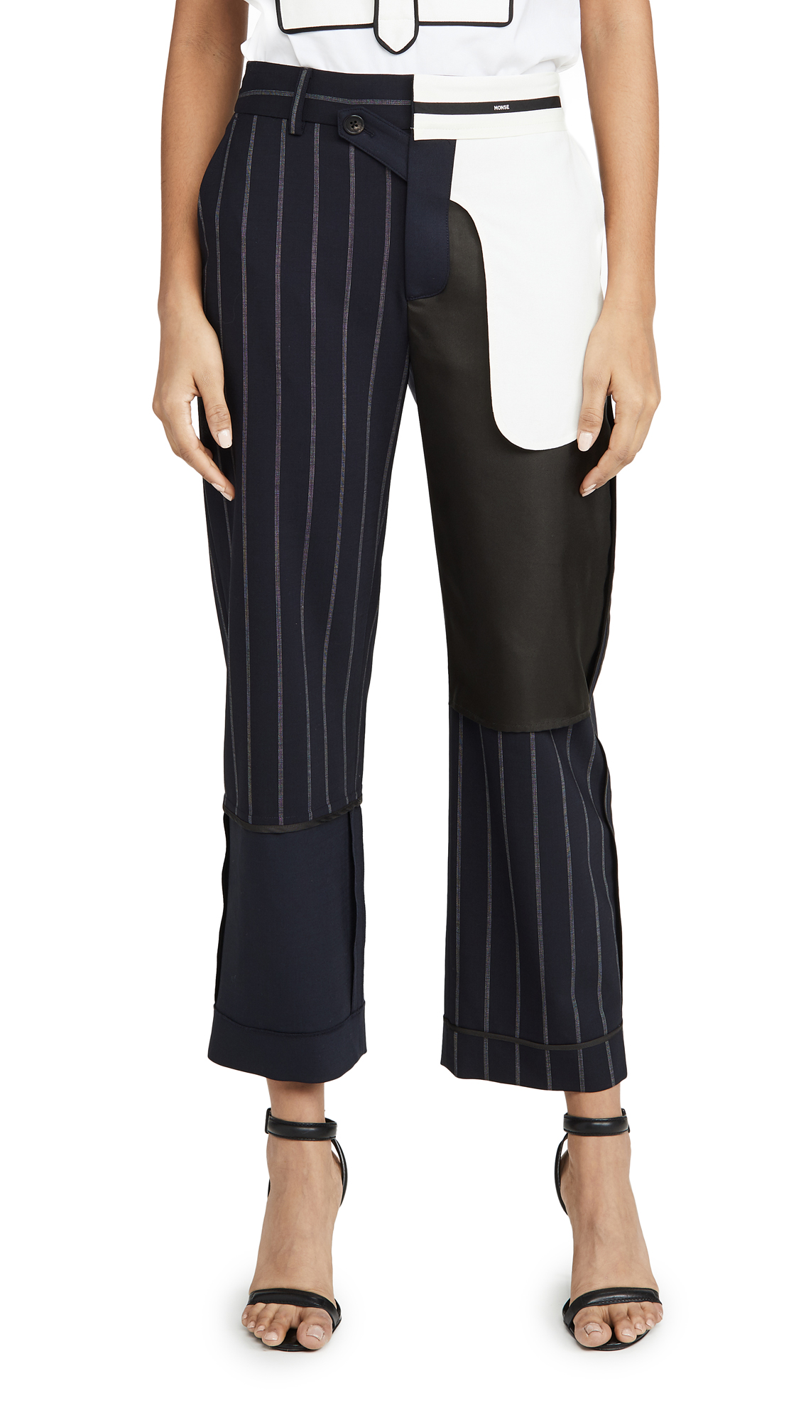 Buy Monse online - photo of Monse Pinstripe Inside Out Patchwork Pants