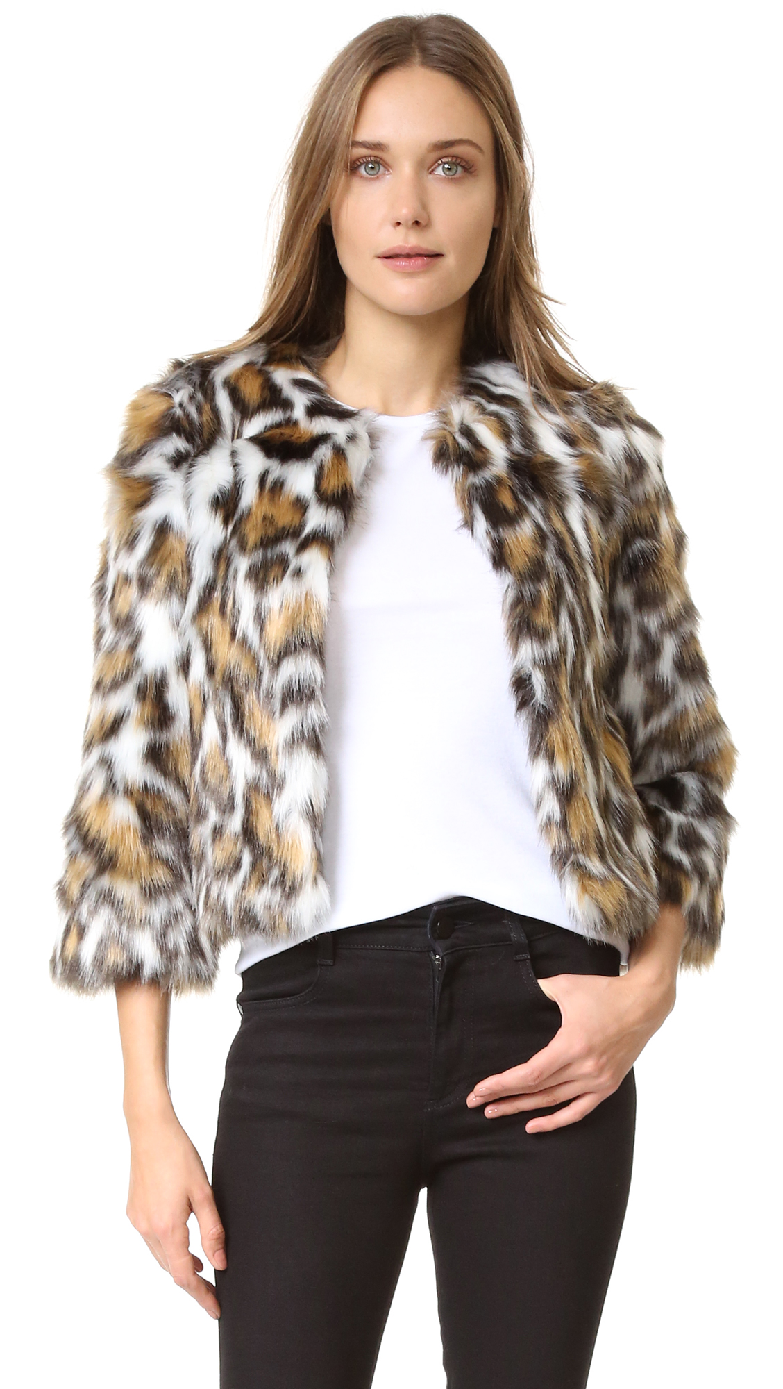 Leopard print faux fur turns this cropped Moschino jacket into a vivid statement piece. Hook and eye closures. Long sleeves. Lined. Fabric: Faux fur. 65% acrylic/35% polyester. Dry clean. Made in Italy. Measurements Length: 18.5in / 47cm, from