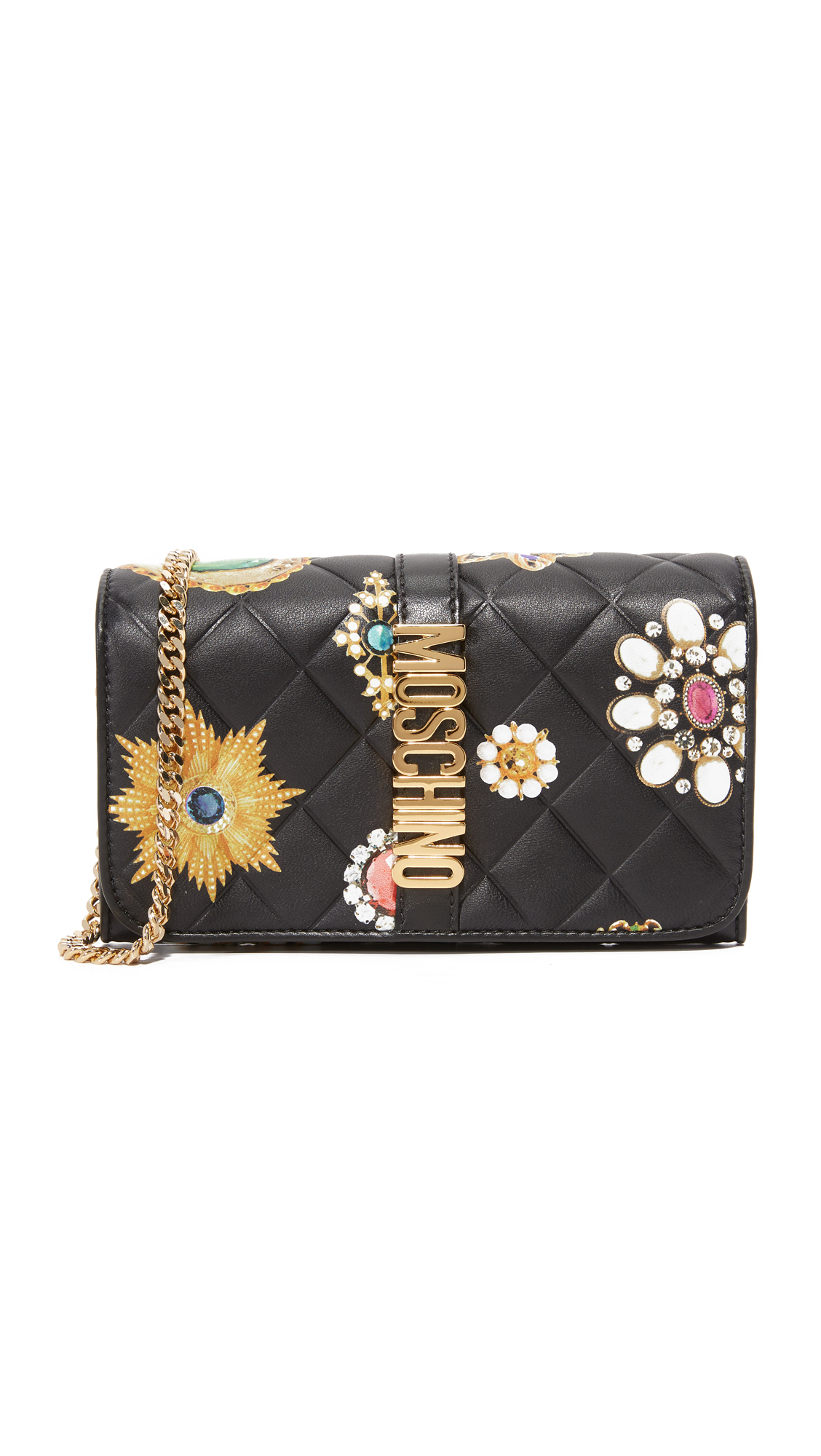 A playful Moschino cross body bag crafted in quilted, jewel printed calfskin. Polished logo letters detail the magnetic front flap. Lined, 2 pocket interior. Dust bag included. Leather: Calfskin. Weight: 12oz / 0.34kg. Made in Italy. Measurements Height: 4.25