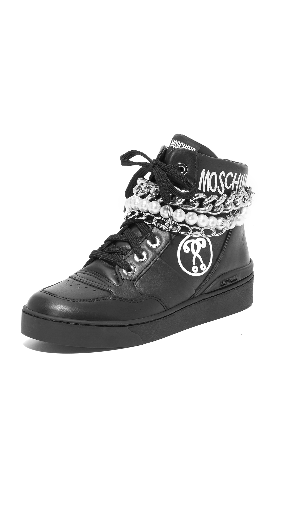 Polished chains and imitation pearls accent the cuff of these high top Moschino sneakers. Contrast logo graphics accent the sides. Lace up closure and rubber sole. Leather: Calfskin. Made in Italy. Measurements Platform: 1in / 25mm. Available