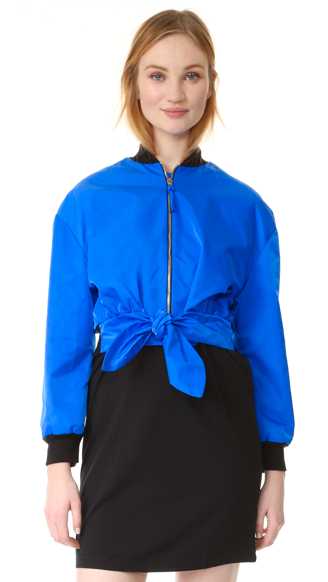 Knotted sashes cinch the cropped waist of this crisp Moschino jacket. Contrast, ribbed edges. Exposed front zip. Long sleeves. Lined. Fabric: Technical weave. Shell: 100% polyamide. Trim: 91% cotton/8% polyamide/1% other fiber. Fill: 100% polyester. Dry clean. Made in