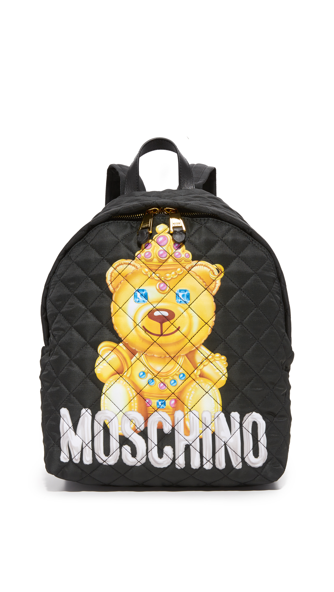 A quilted nylon Moschino backpack with a gilded teddy bear print across the front. The 2 way top zip opens to a satin lined, 3 pocket interior. Top loop and adjustable shoulder straps. Fabric: Quilted nylon. Weight: 20oz / 0.57
