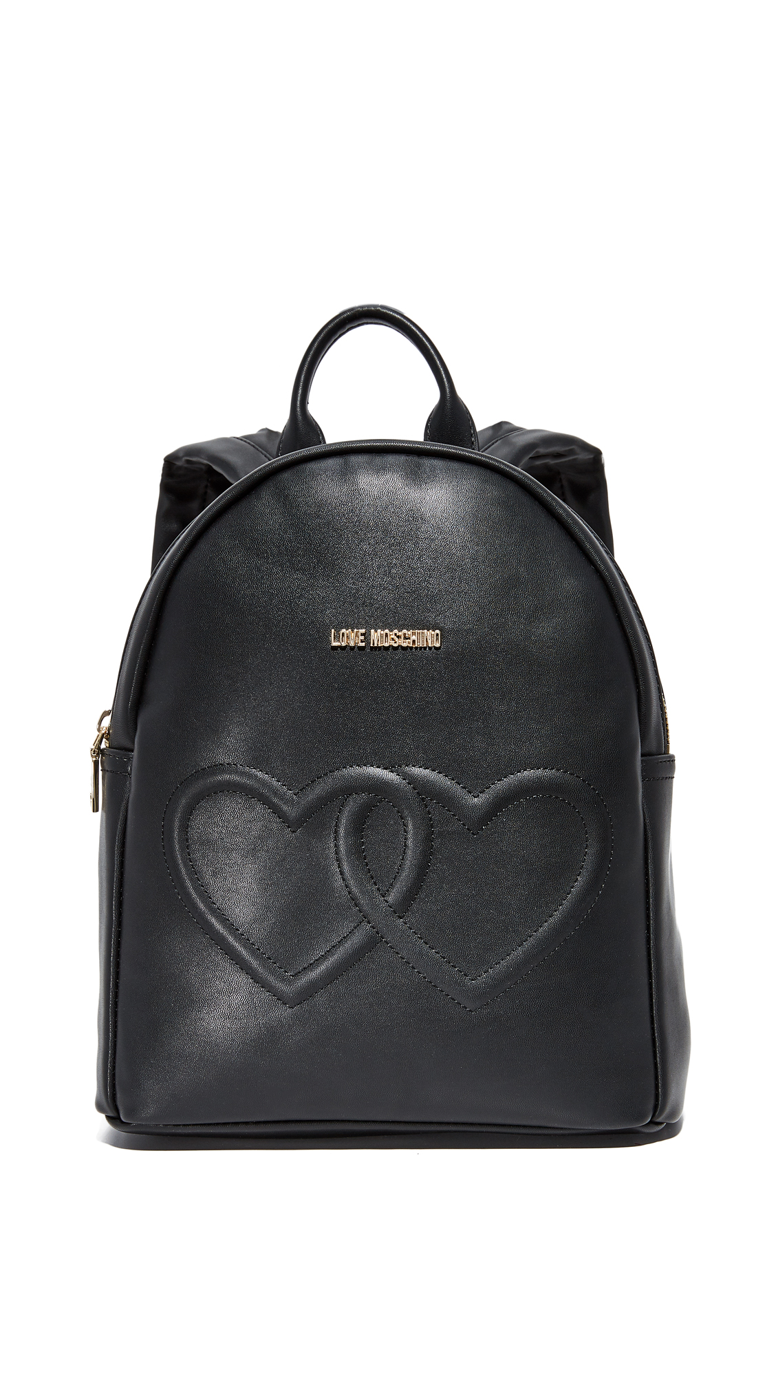 A quilted heart motif and polished logo lettering detail the front of this luxe Moschino backpack. Zip pocket in back. The wraparound top zip opens to a logo lined interior with 1 pocket. Locker loop and adjustable