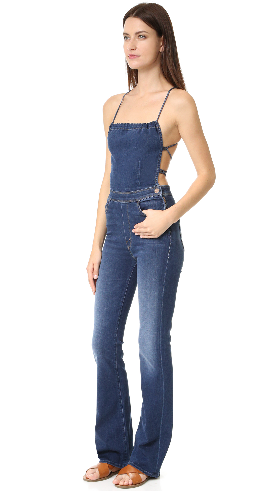 Thin straps crisscross the open back of these faded MOTHER overalls. Slant front pockets and patch back pockets. Exposed side zip. Fabric: Super stretch denim. 50% modal/41% cotton/6% polyester/3% elastane. Wash cold or dry clean. Made in
