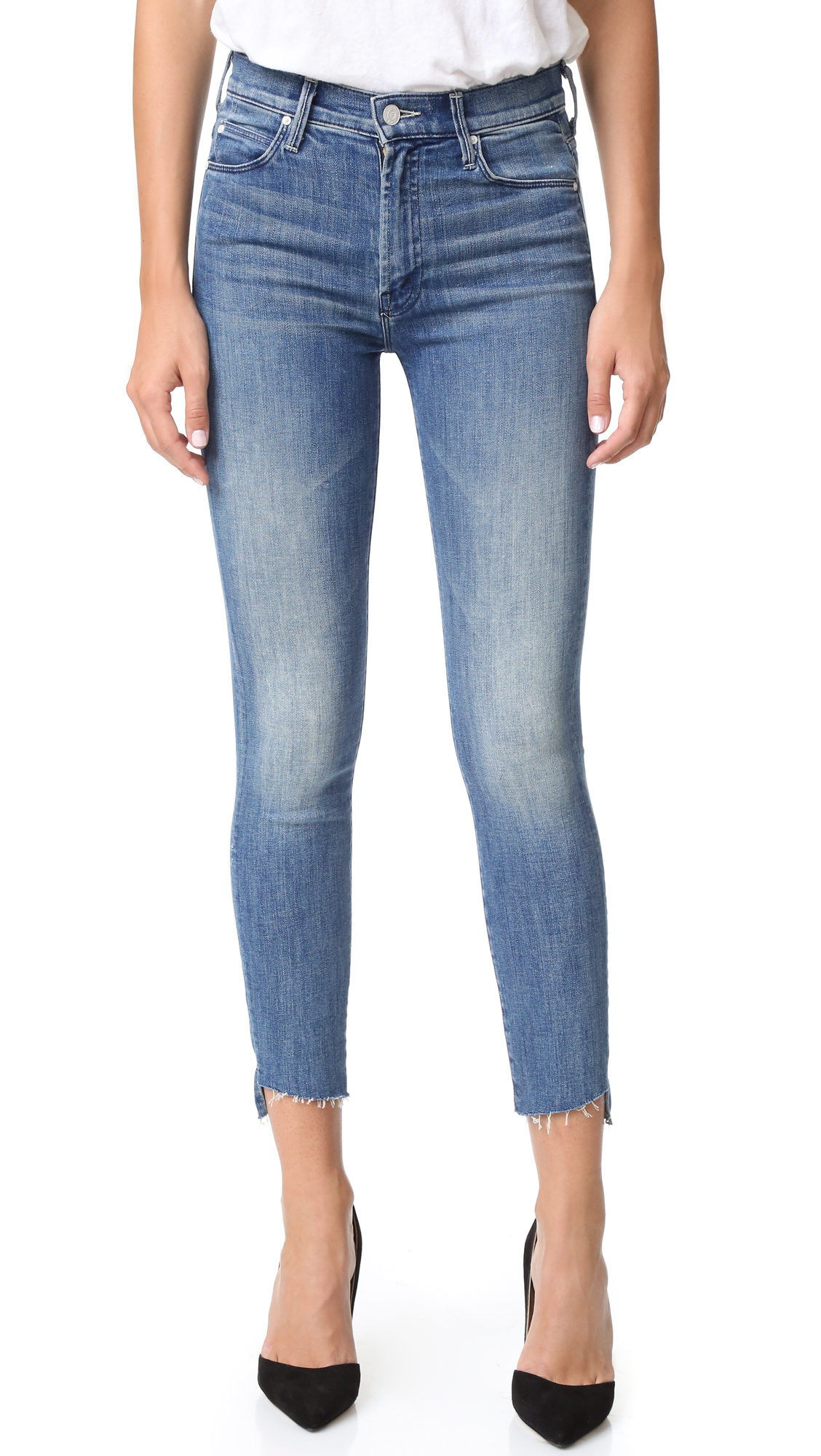 These high rise MOTHER jeans gain vintage inspired charm from raw leg openings, shredded holes, and heavy fading. 5 pocket styling. Button fly. Fabric: Stretch denim. 98% cotton/2% elastane. Wash cold. Made in the USA. Imported materials. Measurements