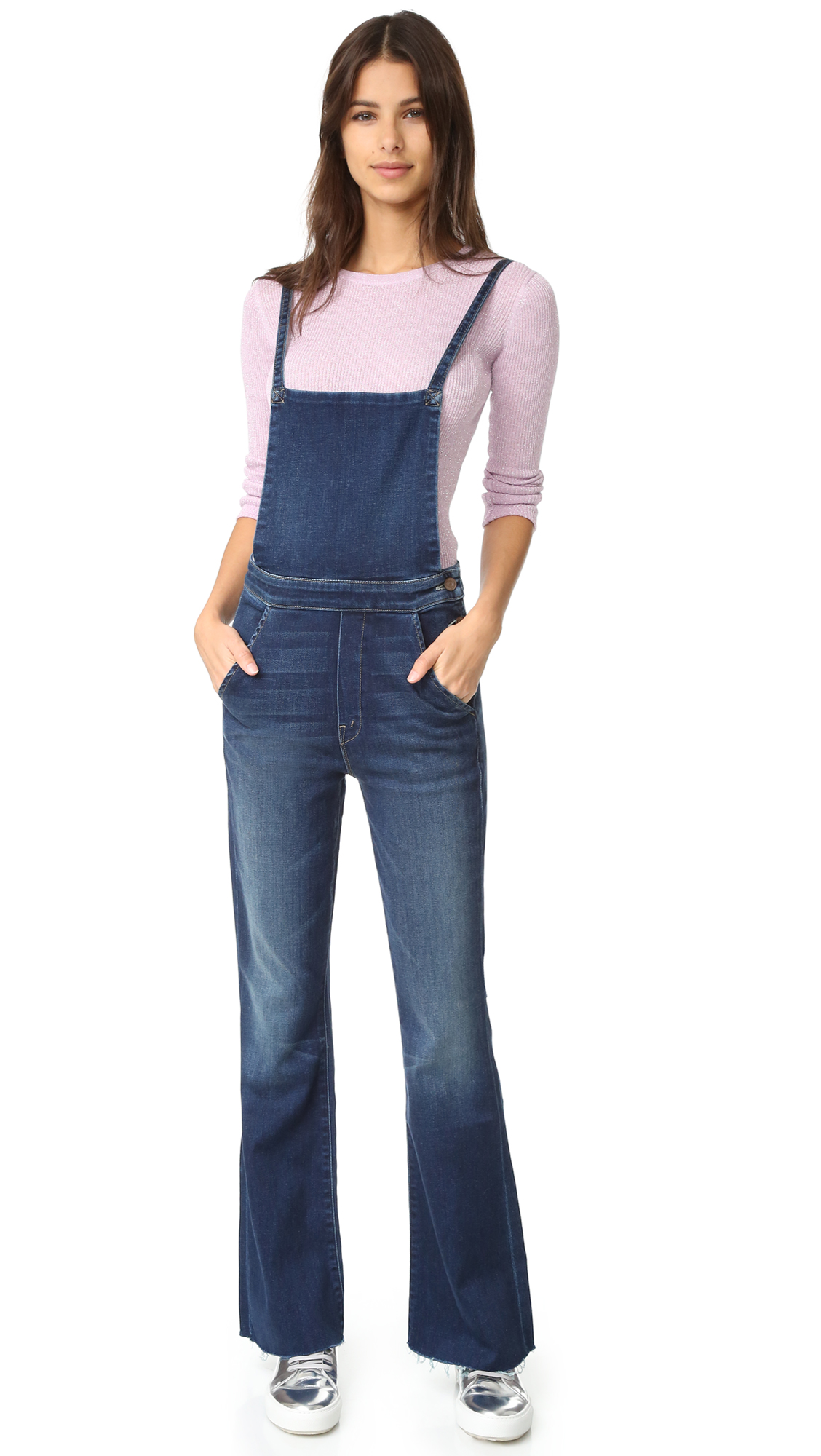 Dark rinse MOTHER overalls with a hint of fading and whiskering. The slim straps may be worn crossed. Slant front pockets and patch back pockets. Button closures at side. Frayed hem. Faux fly. Fabric: Stretch denim. 98%