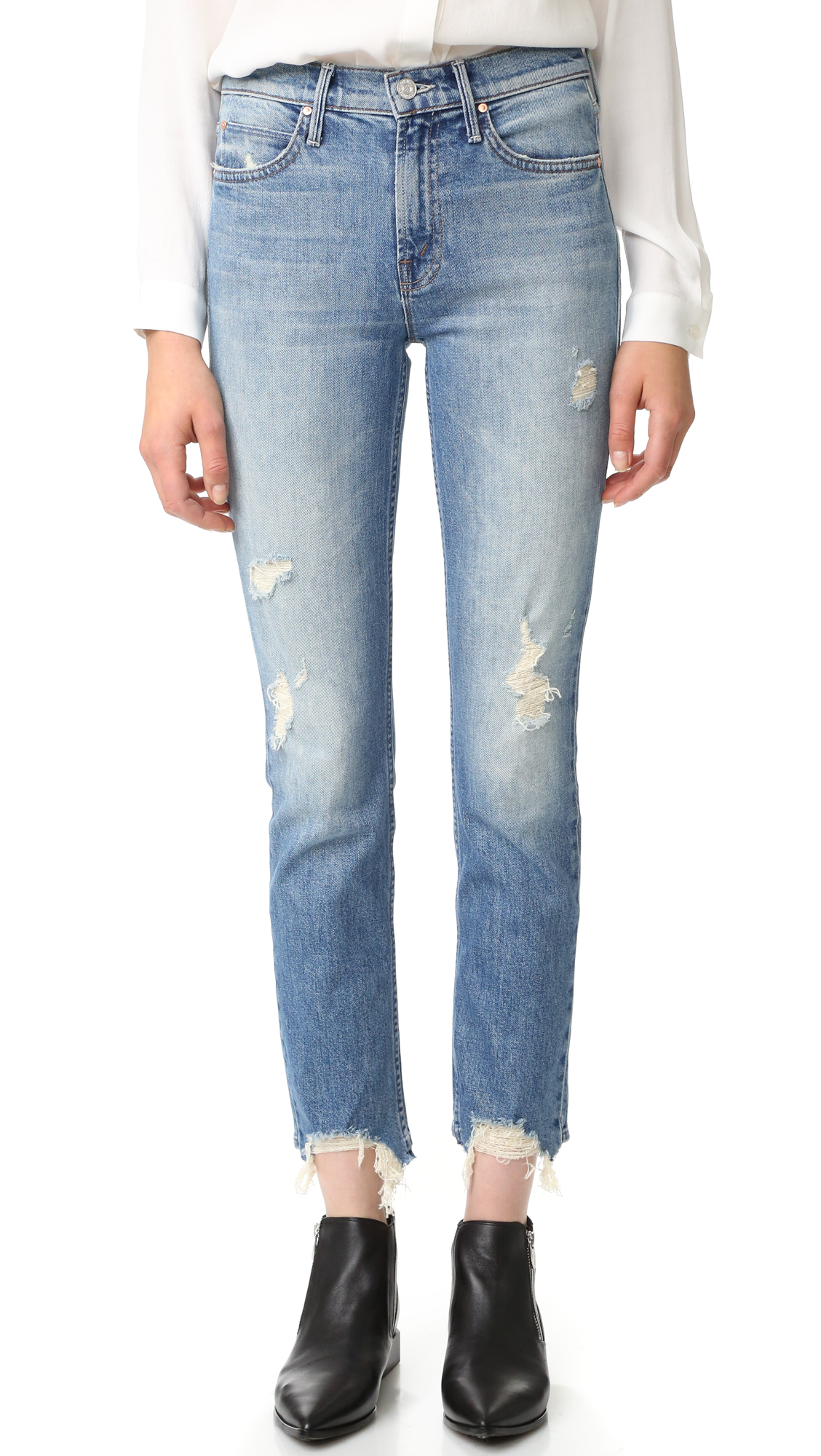Heavy fraying and whiskering create a time worn effect on these faded MOTHER jeans. 5 pocket styling. Button closure and zip fly. Fabric: Stretch denim. 98% cotton/2% elastane. Wash cold. Made in the USA. Imported materials. Measurements Rise: 9.75