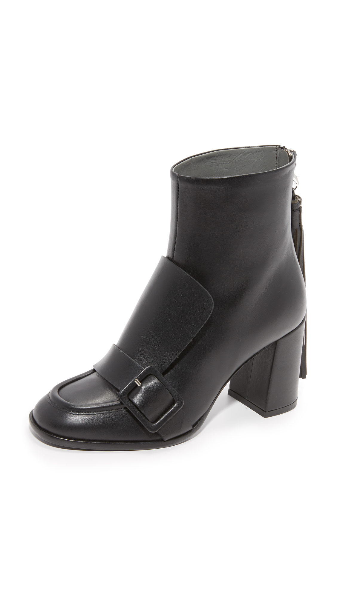 A buckle and an overlay panel add a loafer feel to these eclectic MSGM booties. Long tassel and lobster claw clasp at the hidden back zip. Chunky covered heel and leather sole. Leather: Calfskin. Made in