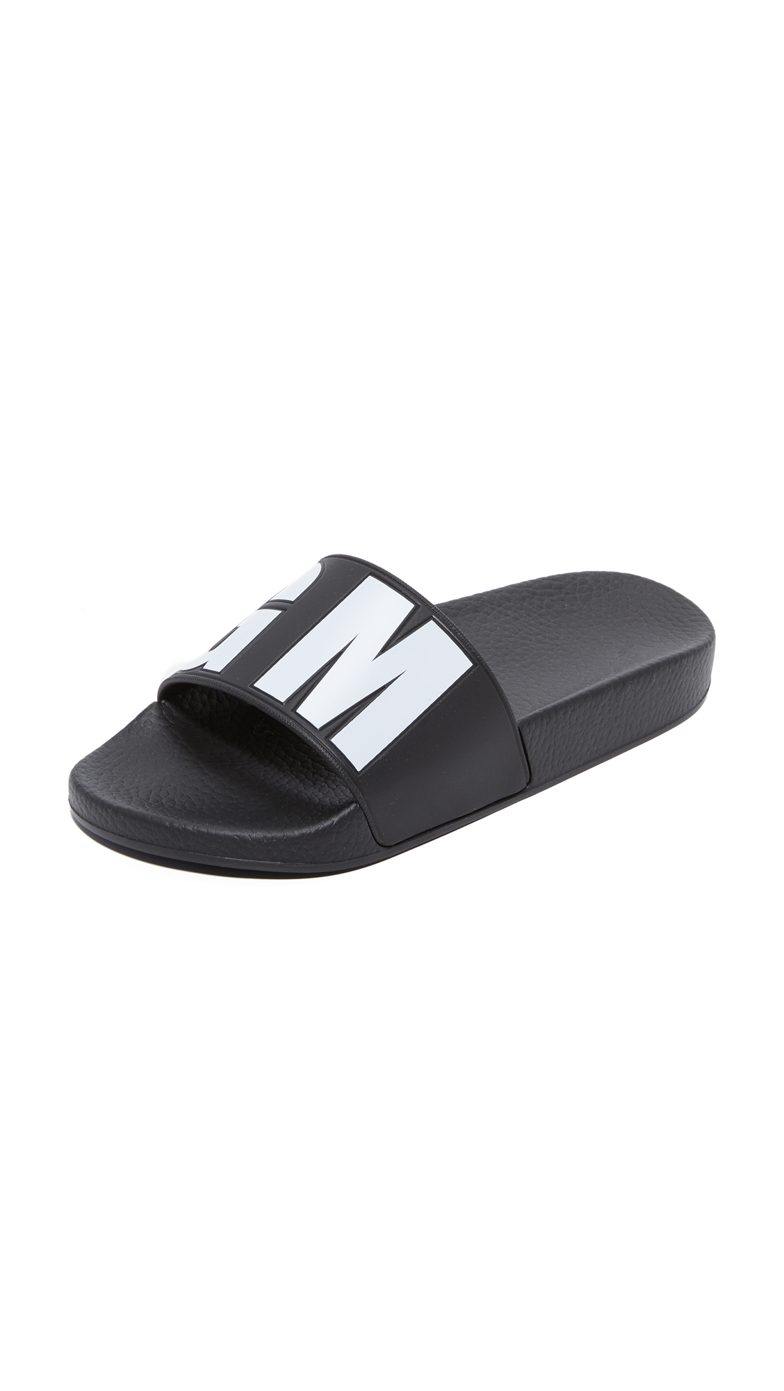 Bold logo lettering adds a graphic touch to these casual MSGM slides. Molded footbed and rubber sole. Fabric: Rubber. Made in Italy. This item cannot be gift boxed. Available sizes: 35,36,37,38,39,40,41