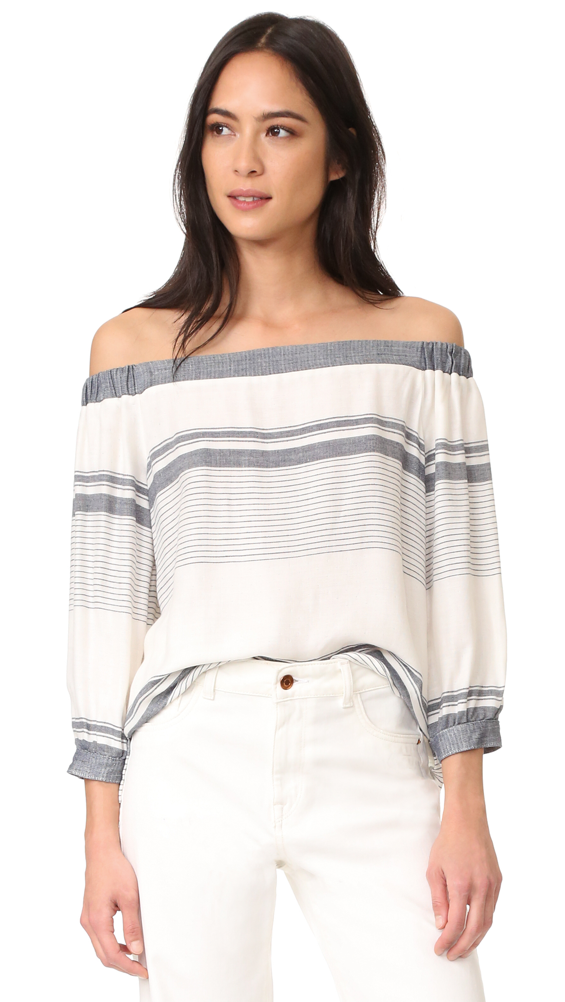 An off shoulder Maven West top crafted in a soft, slinky weave. Covered elastic cinches the shoulders. Long sleeves and single button cuffs. Fabric: Slinky weave. 100% rayon. Dry clean. Made in the USA. Measurements Length: 18.5in / 47