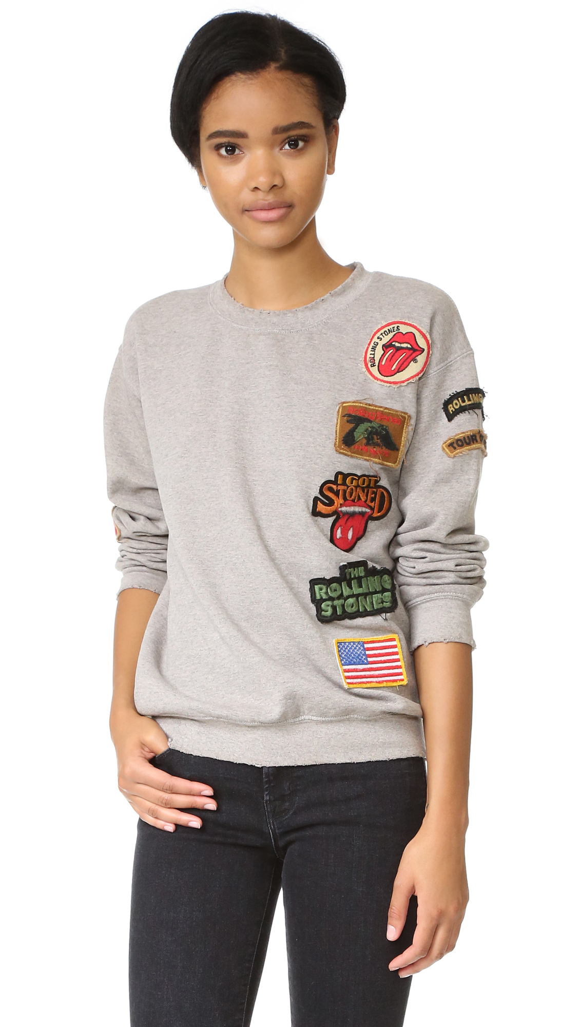 Eclectic patches with a Rolling Stones theme detail this faded MADEWORN ROCK sweatshirt. Banded edges with worn spots. Long sleeves. Fabric: Fleece. 50% polyester/50% cotton. Wash cold. Made in the USA. Patches on item may vary. Measurements