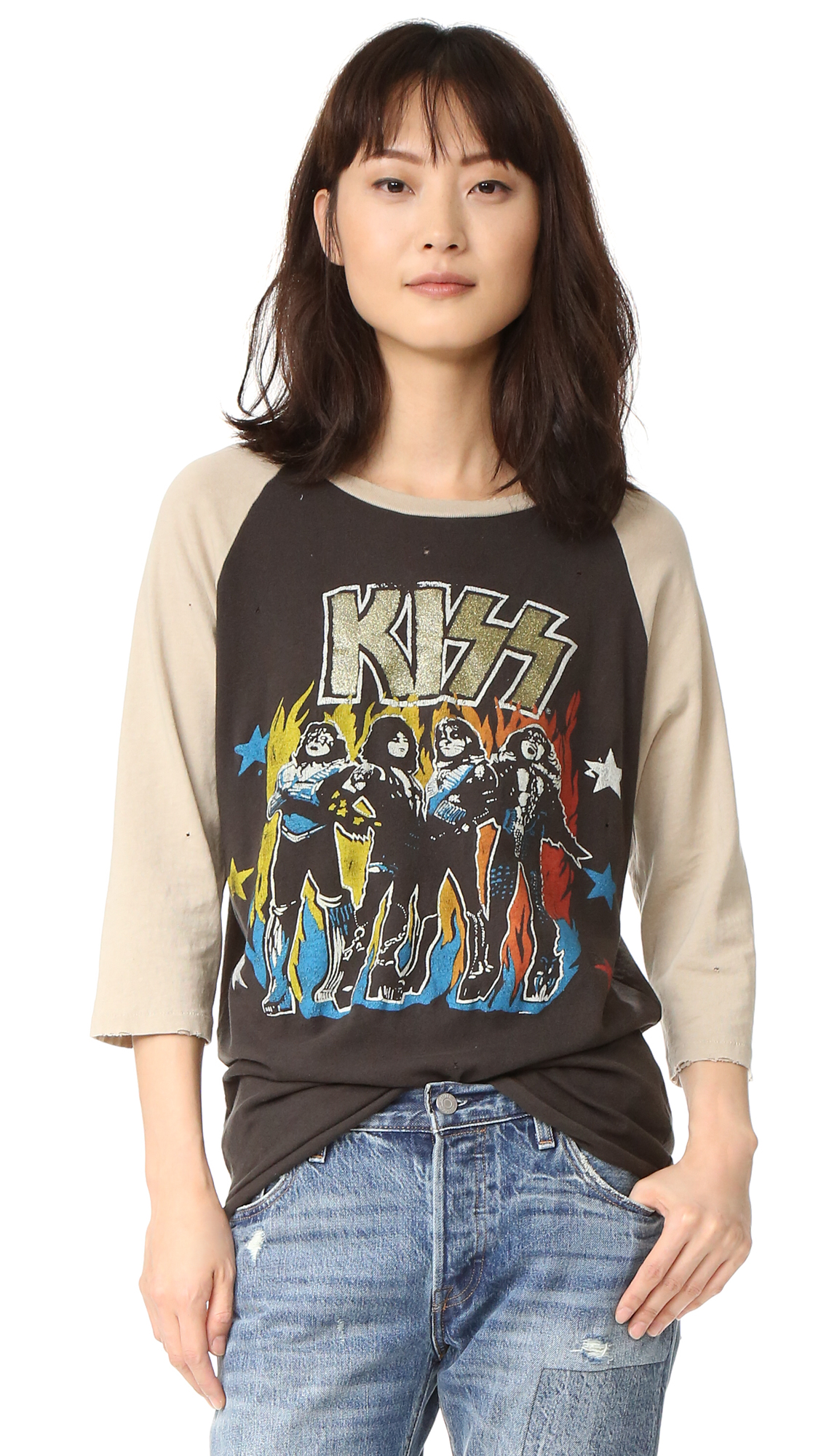 This soft, well traveled MADEWORN ROCK tee is detailed with a faded screenprint of KISS in the front. Tiny holes add to the vintage look. Serged, rounded hem. 3/4 raglan sleeves. Fabric: Soft, worn jersey. 100% cotton. Wash