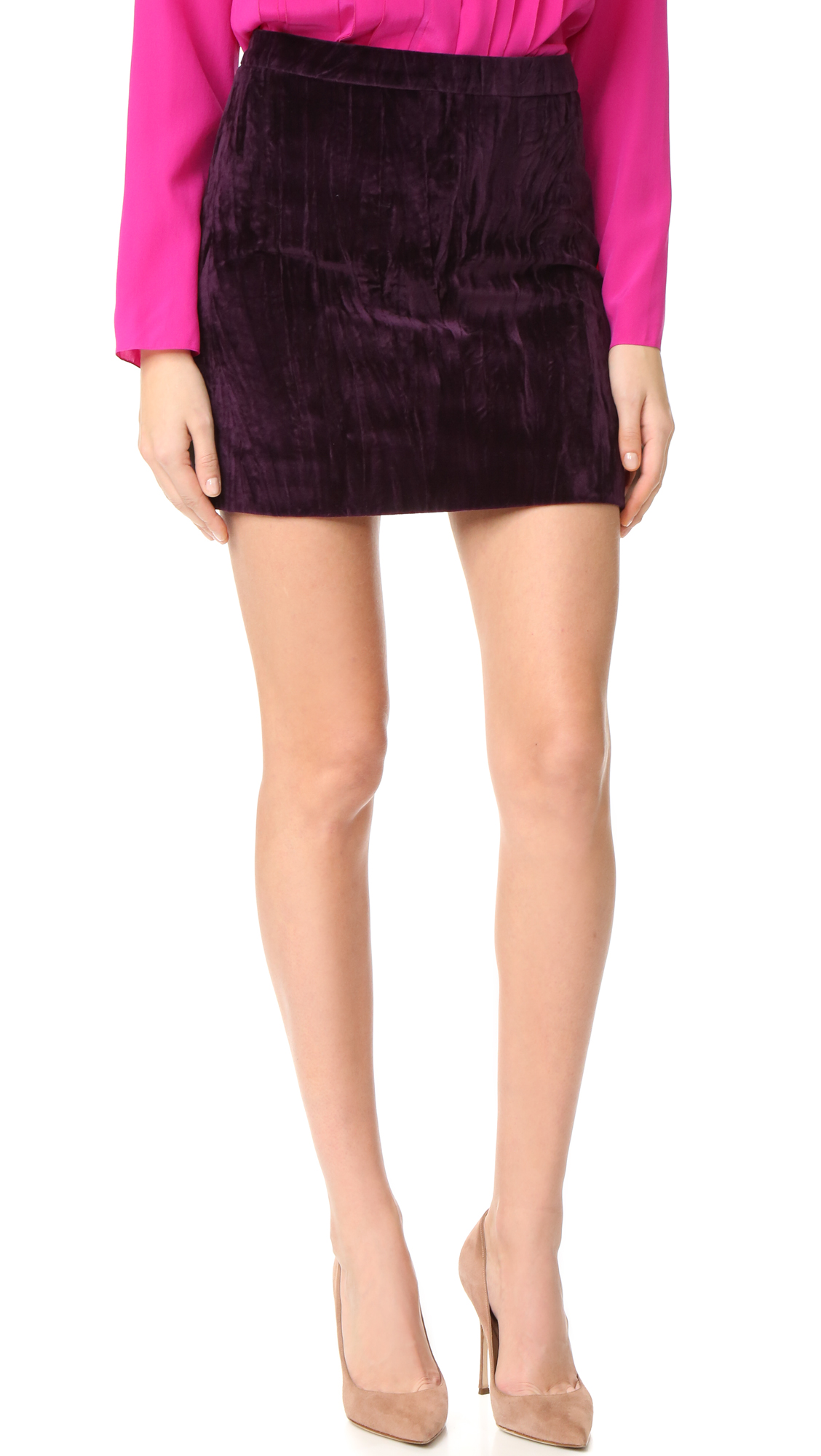 Soft velvet gives this Nina Ricci miniskirt a luxe, retro inspired look. Hidden back zip. Lined. Fabric: Velvet. Shell: 100% cotton. Lining: 71% acetate/29% silk. Dry clean. Made in France. Measurements Length: 15.25in / 39cm, from shoulder Measurements from