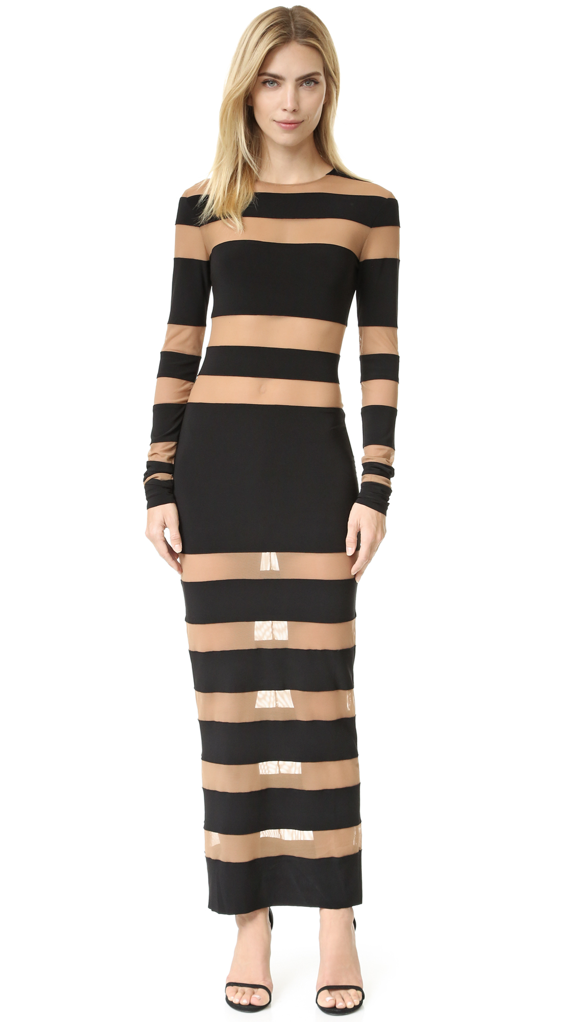 A formfitting Norma Kamali dress has a barely there look, composed of panels of soft jersey and sheer sand tone mesh. Exaggerated long sleeves. Unlined. Semi sheer. Fabric: Jersey / mesh. Shell: 95% polyester/5% spandex. Trim: 82% nylon/18% spandex.