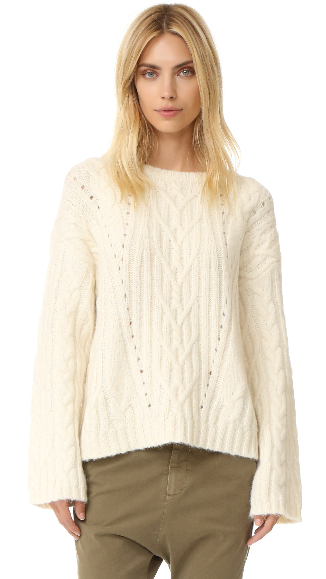 A slouchy Nili Lotan sweater in a warm alpaca blend. Intricate cable detailing adds a classic touch. Ribbed edges. Fabric: Cable knit. 68% alpaca/22% polyamide/10% wool. Dry clean. Imported, China. Measurements Length 1: 23.25in / 59cm, from shoulder to