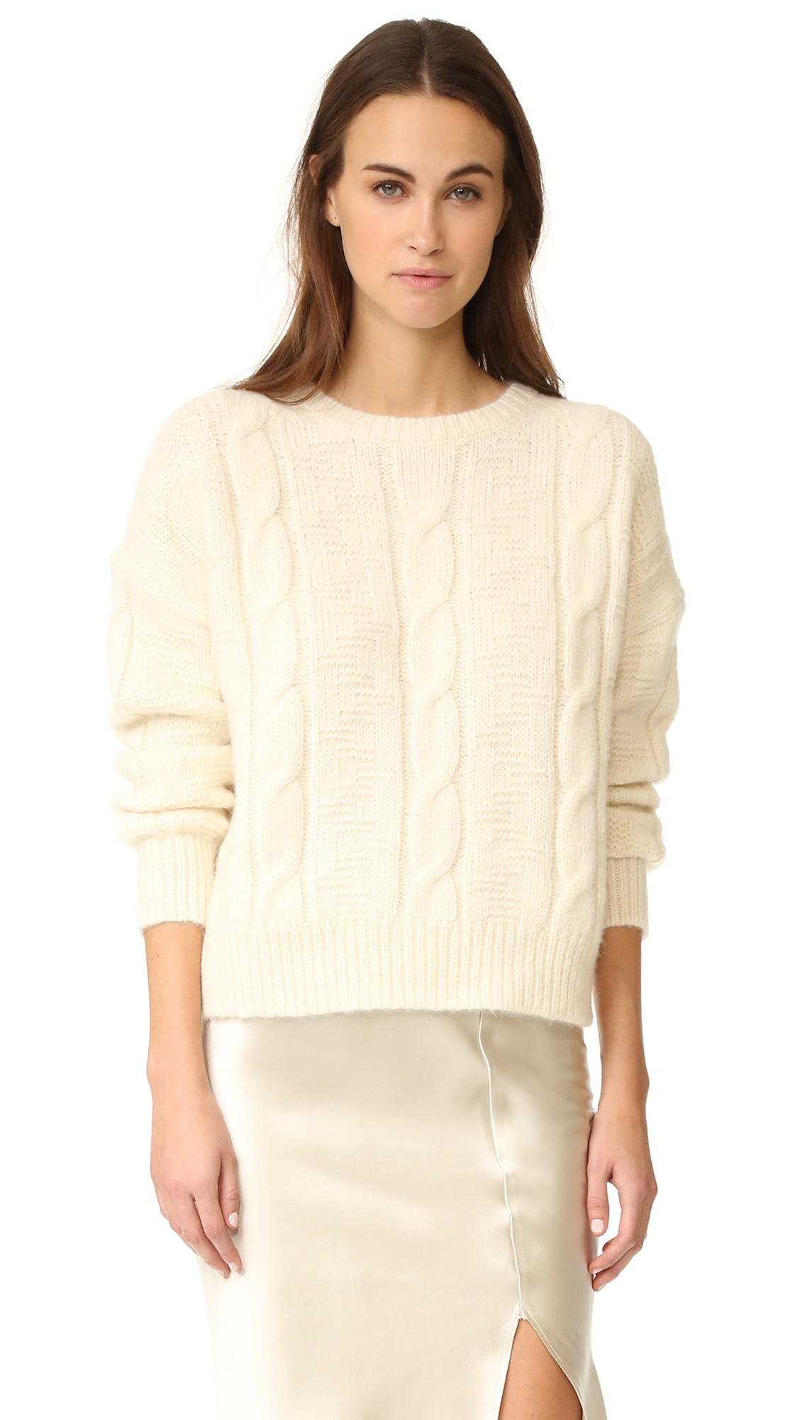 Vertical cables and raised stitches bring cozy texture to this plush Nili Lotan sweater. Dropped shoulder seams relax the boxy shape. Crew neckline. Long sleeves. Fabric: Soft cable knit. 68% alpaca/22% polyamide/10% wool. Dry clean. Imported, China.