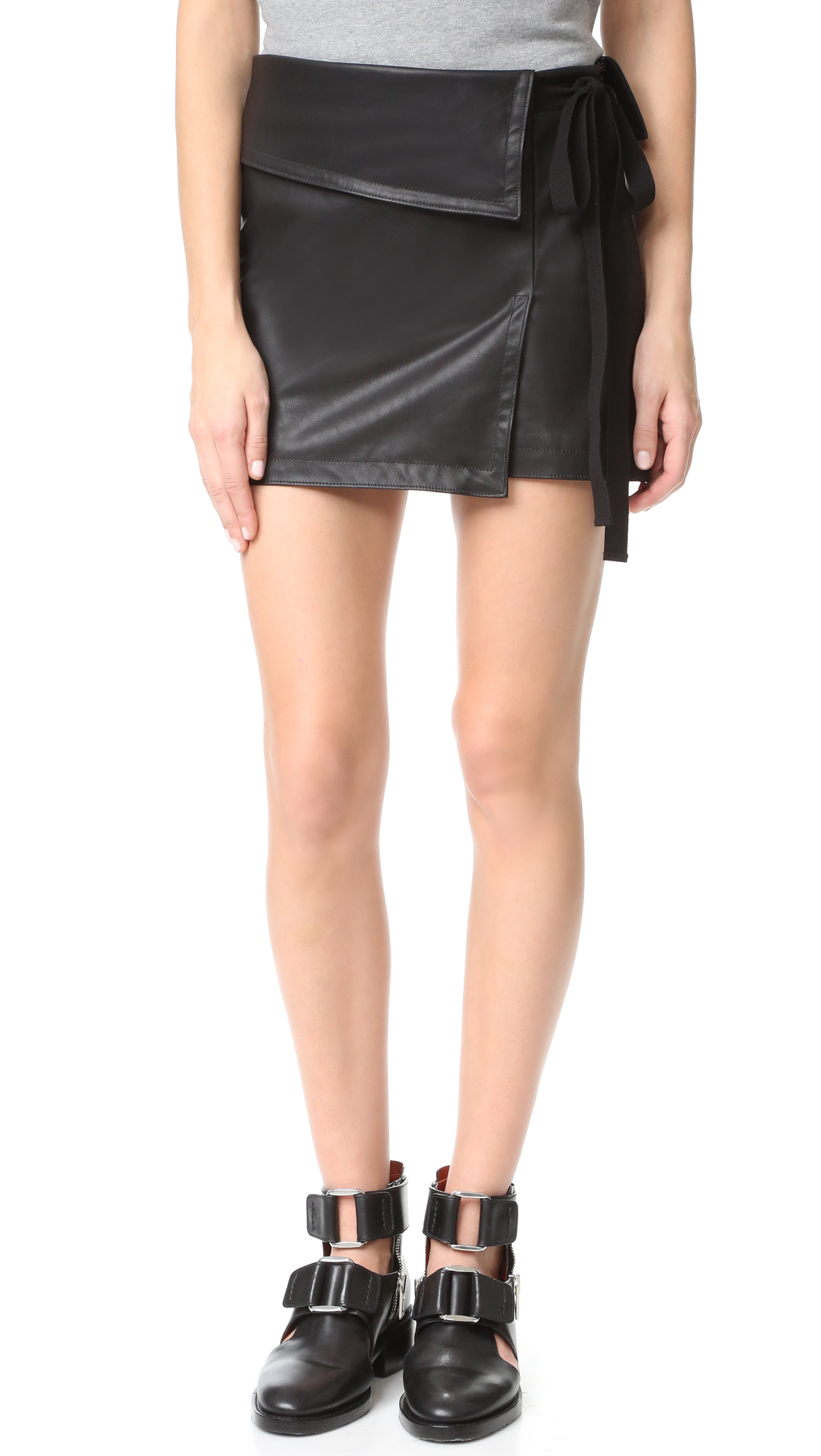 A sexy No. 21 miniskirt in slick faux leather. Angled overlays and a draped hem create an asymmetrical look. Tonal ribbon trim. Hidden side zip. Lined. Fabric: Faux leather. Shell: 97% polyester/3% elastane. Trim: 100% polyurethane. Lining: 100% cupro. Dry