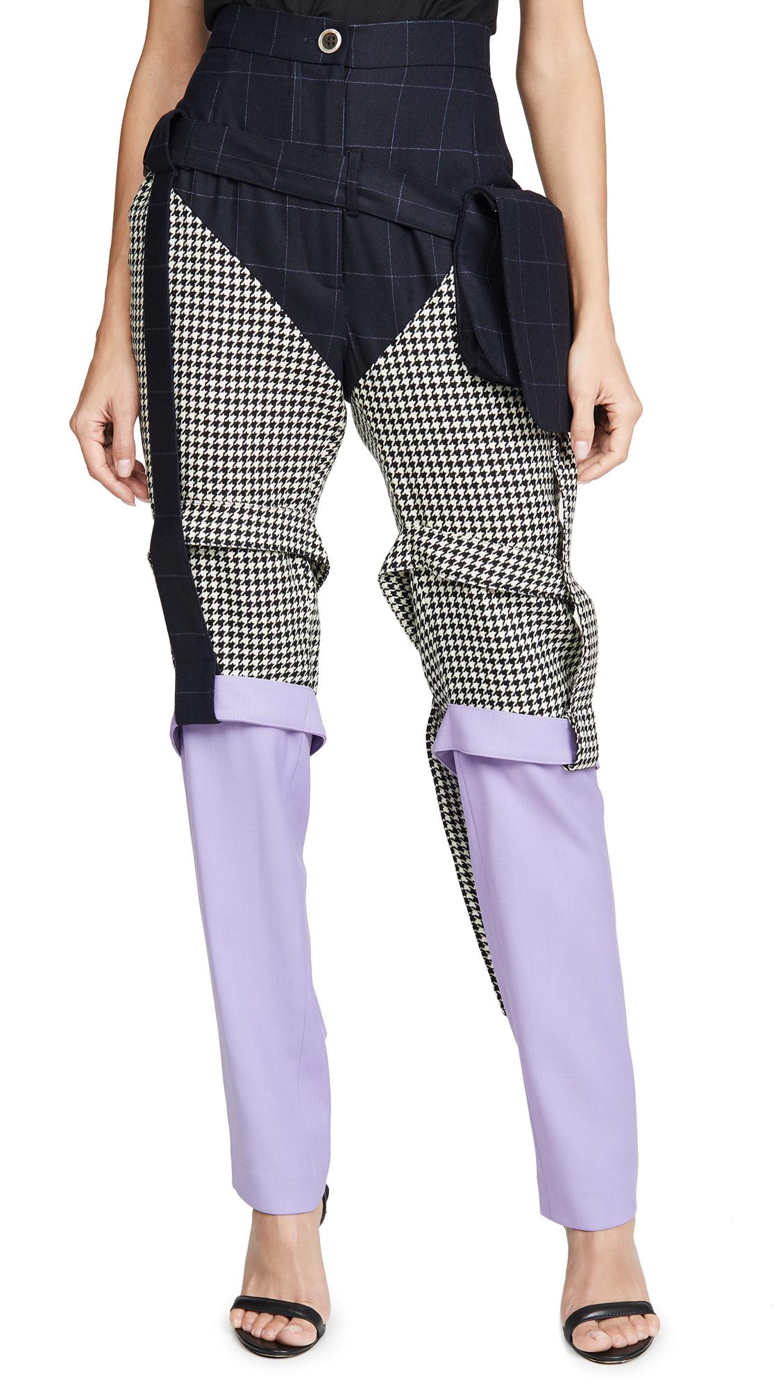 Buy Natasha Zinko online - photo of Natasha Zinko Triple Panel Bag Strap Trousers