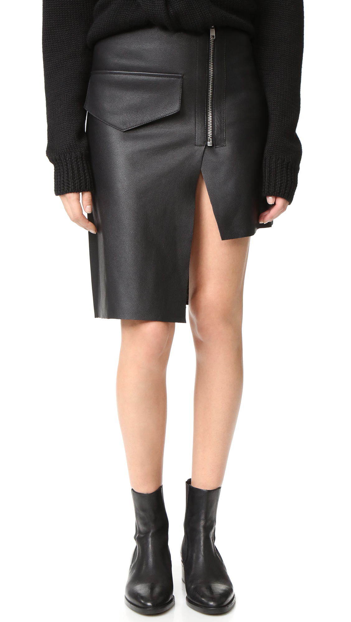 A leather Oak skirt with a unique, minimalist aesthetic. An oversized, faux pocket details the front, and the split hem drapes to an exaggerated, uneven shape. Laser cut edges. Exposed zip. Unlined. Fabric: Pebbled leather. 100% cowhide.