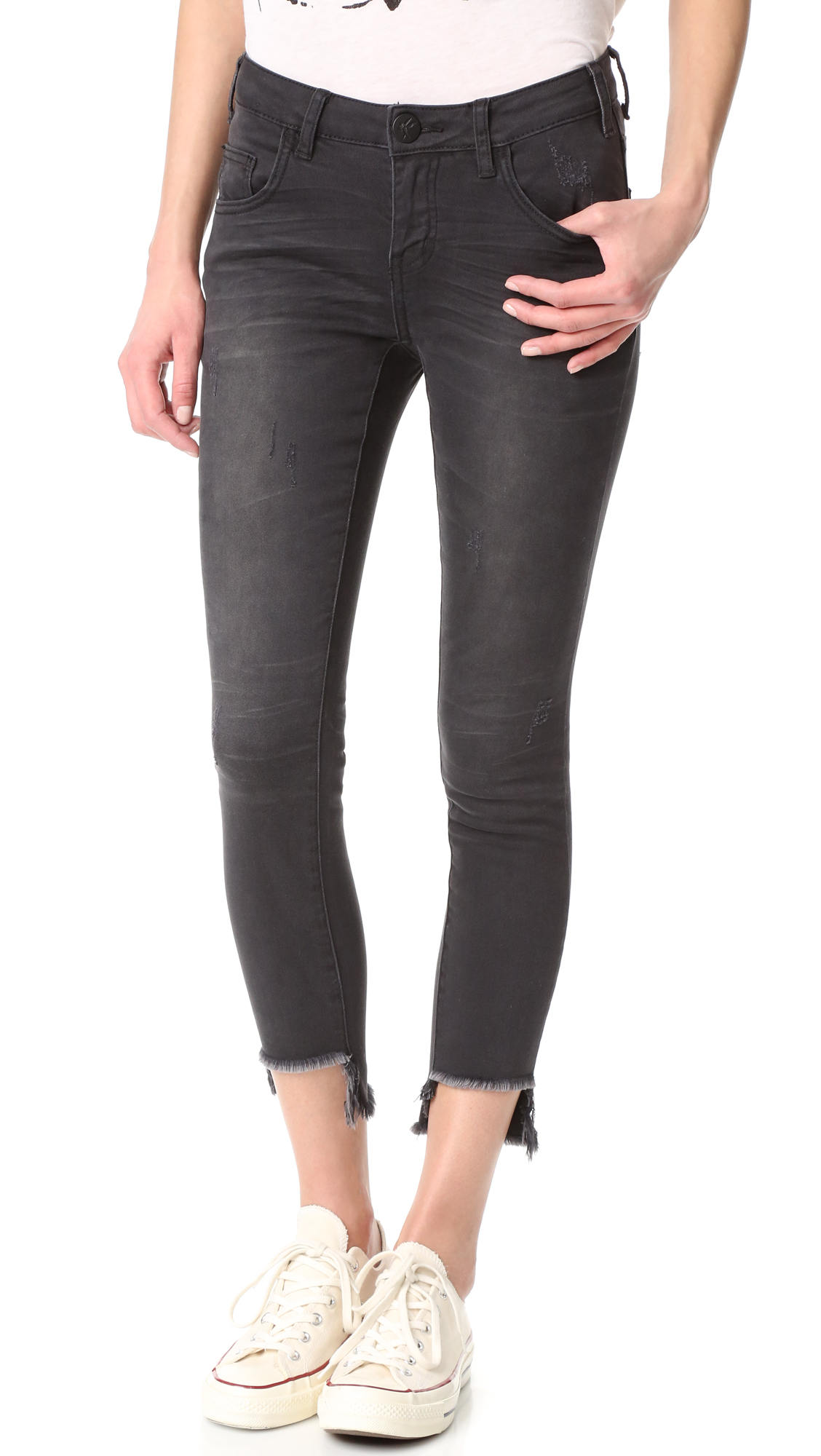 Edgy, dark wash One Teaspoon jeans with light fading and frayed, step hem cuffs. 5 pocket styling. Button closure and zip fly. Fabric: Stretch denim. 98% cotton/2% elastane. Wash cold. Imported, China. Measurements Rise: 7.75in / 20cm Inseam: 24.75in / 63