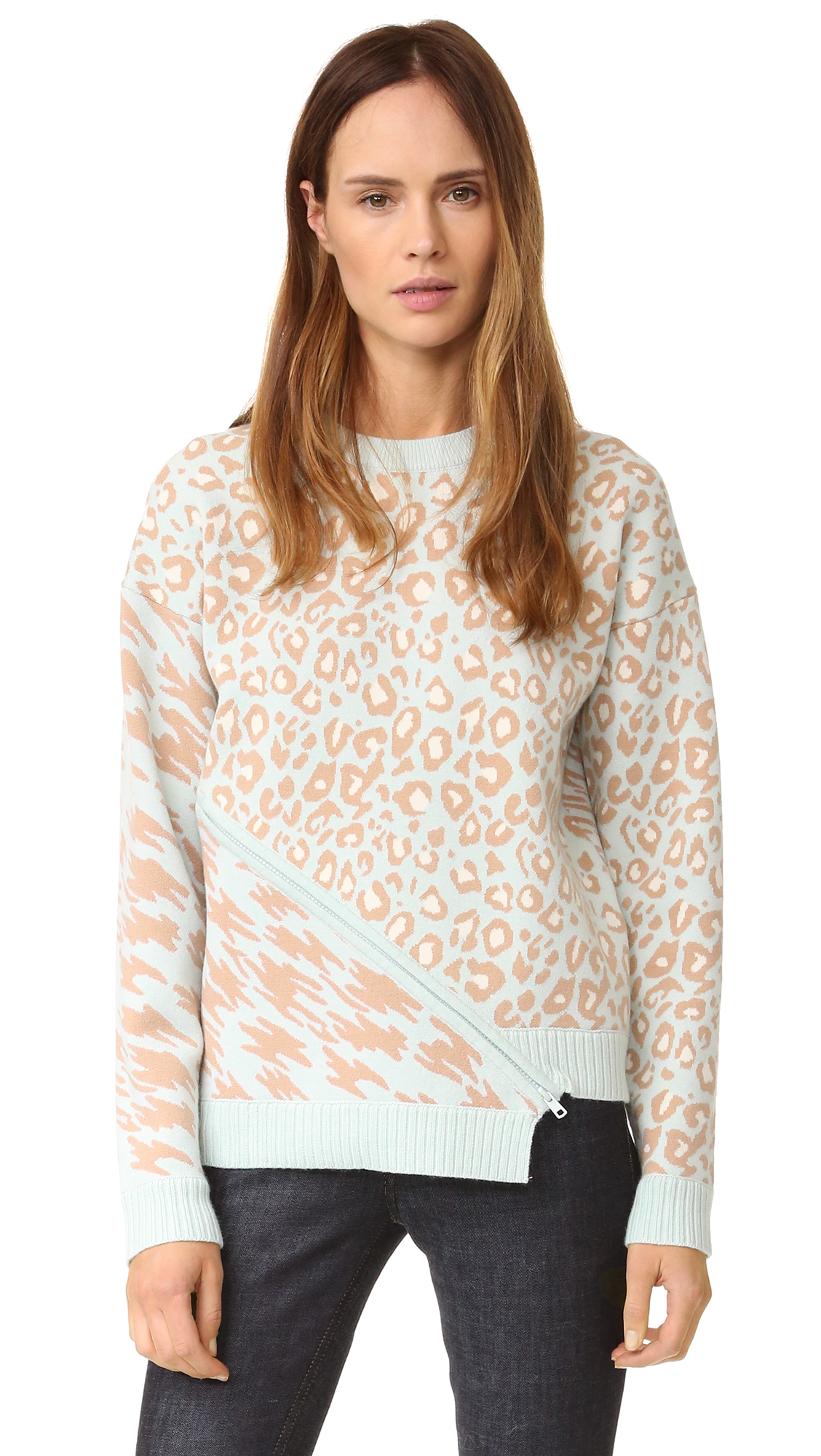 Plush double knit lends comfortable weight to this mixed print Opening Ceremony sweatshirt. An angular zipper vent relaxes the uneven hem. Dropped shoulder seams and long sleeves. Ribbed edges. Fabric: Double knit. 31% acrylic/31% merino wool/18% spandex/14%