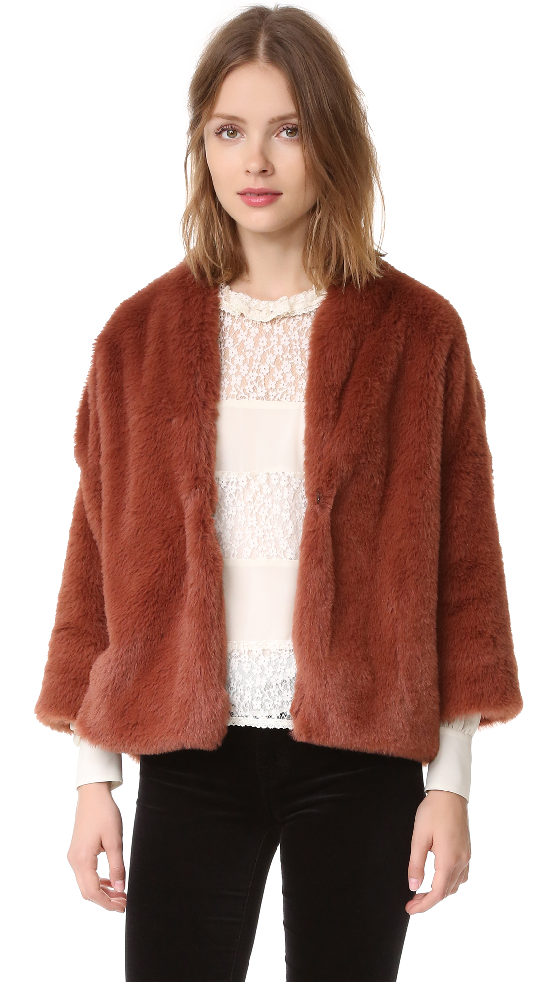 An Otto d'ame jacket made from plush faux fur. A hook and eye closure fastens the placket. Uneven hem. 3/4 sleeves. Lined. Fabric: Faux fur. Shell: 100% polyester. Lining: 100% viscose. Dry clean. Made in Italy. Measurements Length: 24.5in / 62