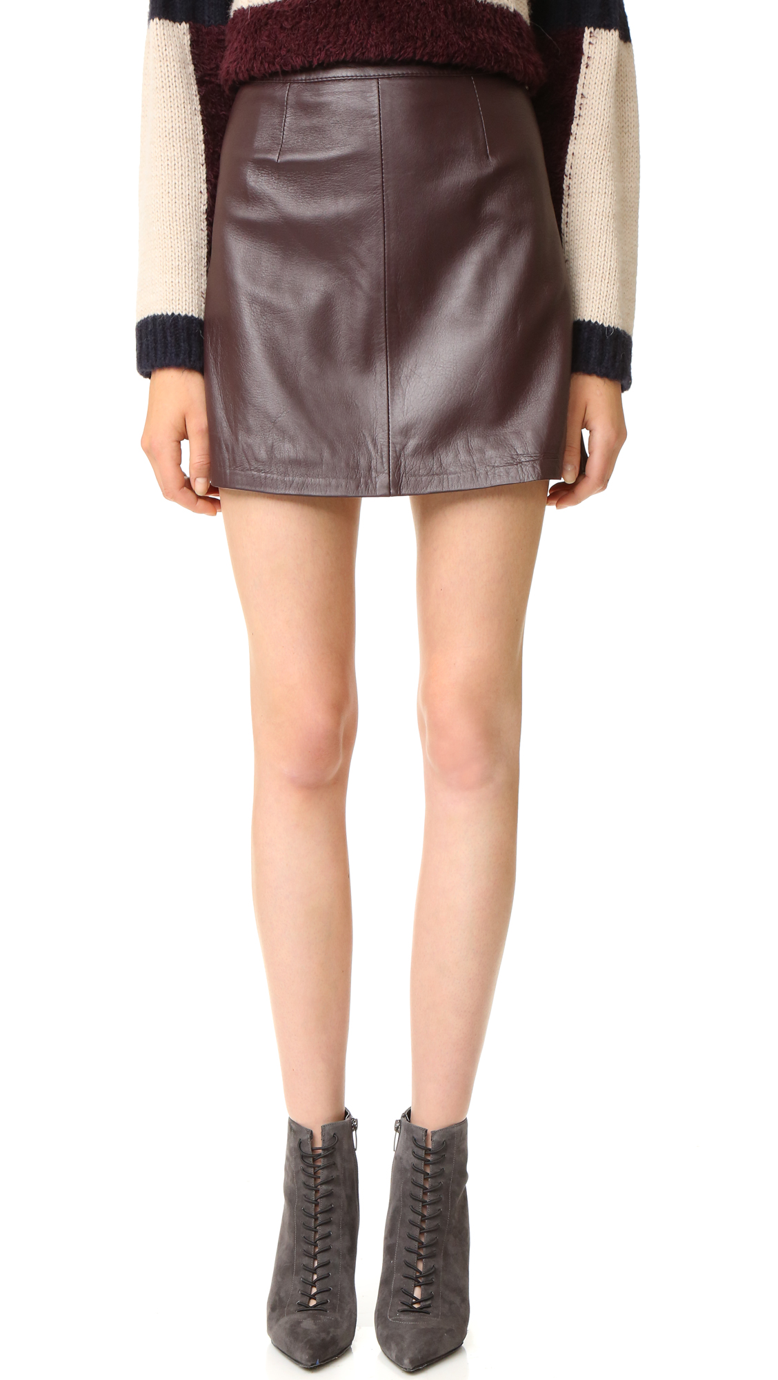 A leather Otto d'ame miniskirt in a classic A line profile. Back zip. Lined. Fabric: Soft leather. 100% sheepskin. Leather clean. Made in Italy. Measurements Length: 16.5in / 42cm Measurements from size 40. Available sizes: 44