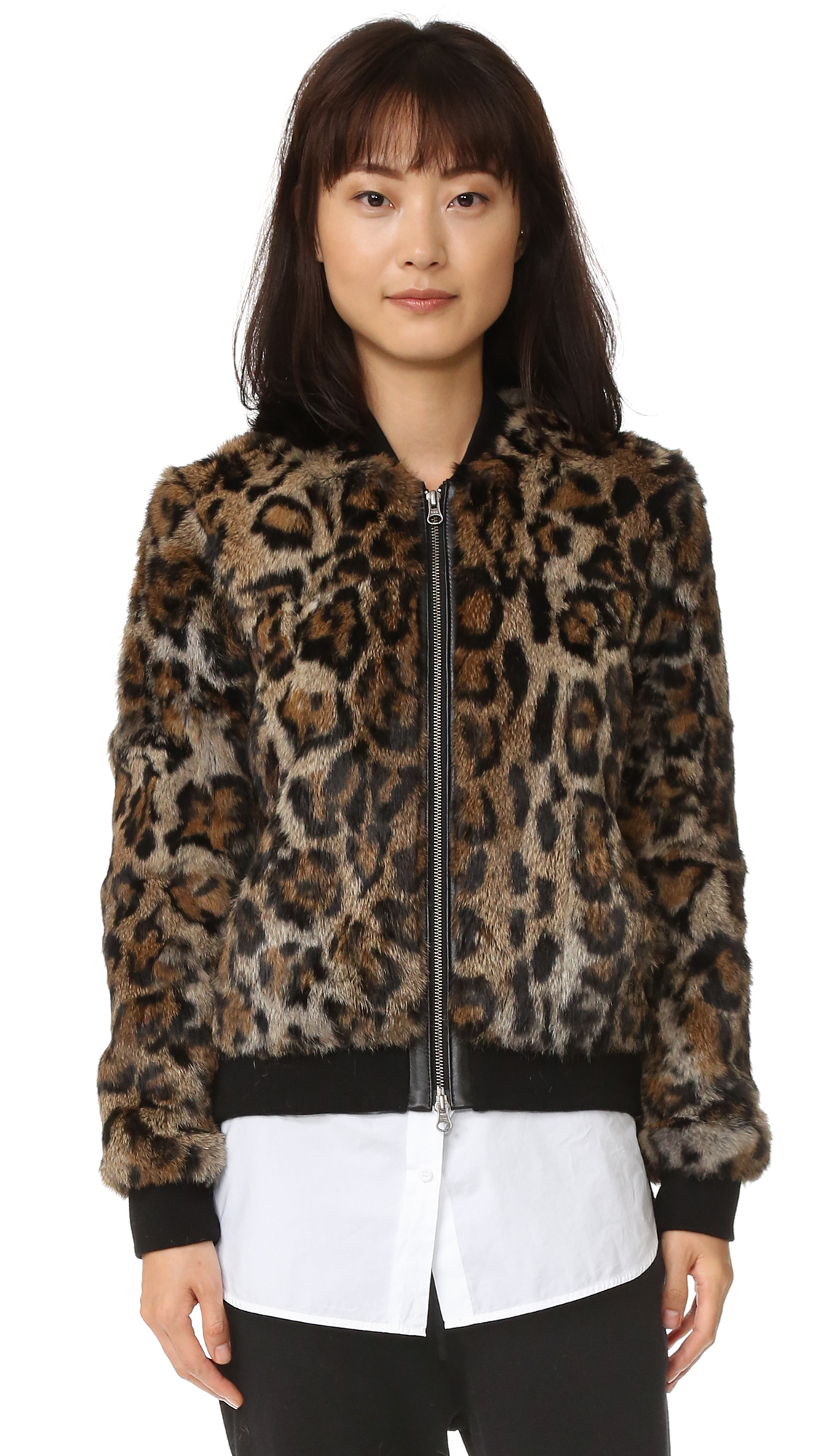 Leopard print rabbit fur lends edgy glamour to this Pam & Gela bomber jacket. Ribbed collar and edges. Exposed zips at the placket and split hem. Front slant pockets. Lined. Fur: Dyed rabbit, from China. Trim: 100% cotton.