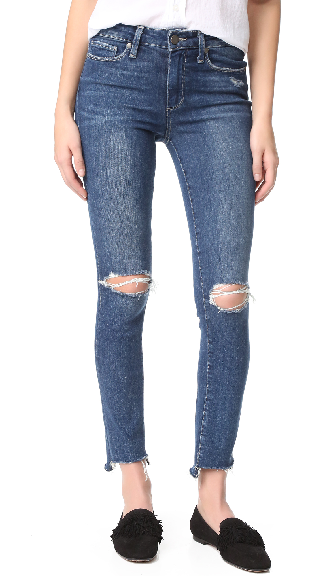 Open holes at the knees and frayed edges accentuate the favorite pair feel of these cutoff PAIGE skinny jeans. 5 pocket styling. Button closure and zip fly. Fabric: Stretch denim. 95% cotton/4% polyester/1% elastane. Wash cold. Made in