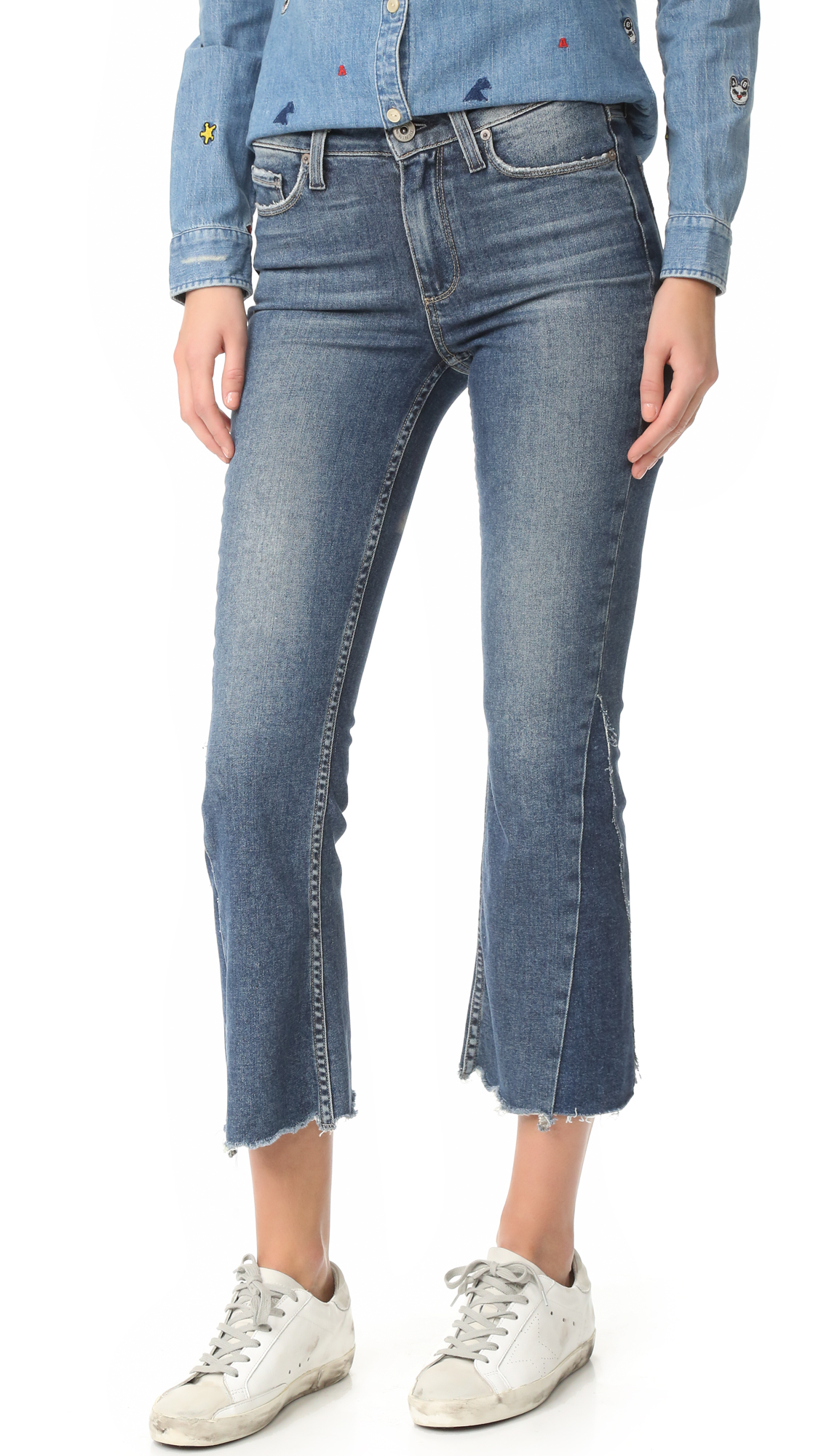 Cropped, faded PAIGE flares with frayed cuffs and gusseted sides. Worn edges. 5 pocket styling. Button closure and zip fly. Fabric: Stretch denim. 93% cotton/6% polyester/1% spandex. Wash cold. Made in the USA. Measurements Rise: 9.5in / 24cm Inseam: 26