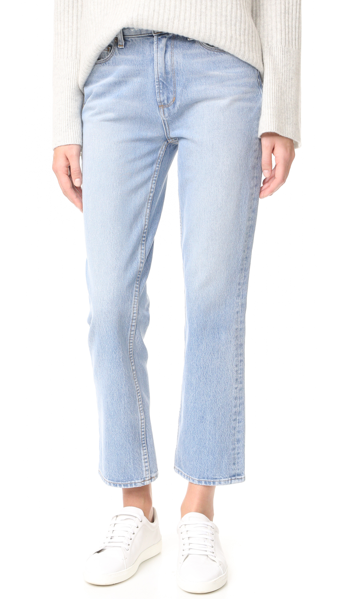 Heavy fading and whiskering lighten the wash of these PAIGE straight leg jeans. 5 pocket styling. Button closure and zip fly. Fabric: Stretch denim. 98% cotton/2% elastane. Wash cold. Made in the USA. Imported materials. Measurements Rise: 11in / 28