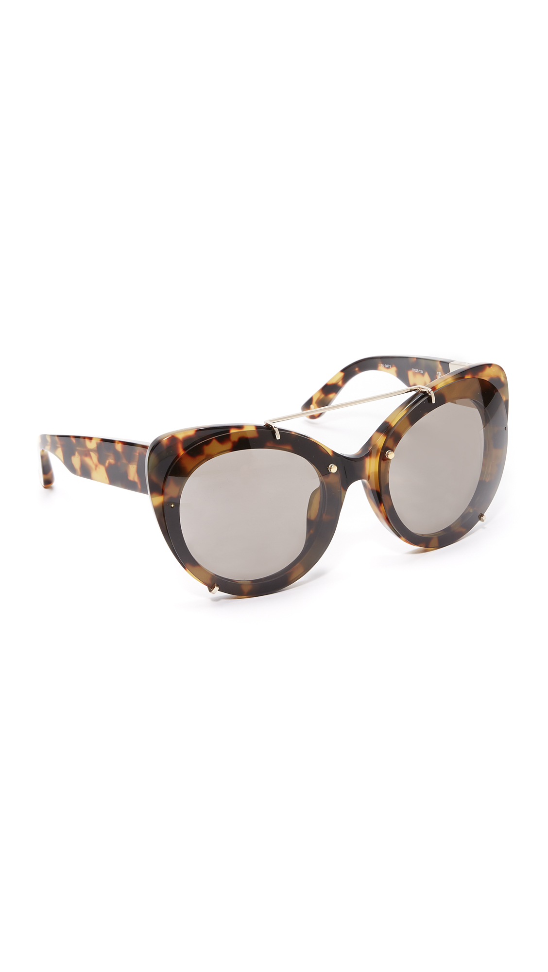 Oversized, cat eye 3.1 Phillip Lim sunglasses with raised lenses. Soft pouch included. Cateye frame. Non polarized lenses. Imported, Japan. Measurements Width: 6in / 15.5cm Height: 2.25in / 6cm Lens Width: 55mm A manufacturer's warranty for this item can