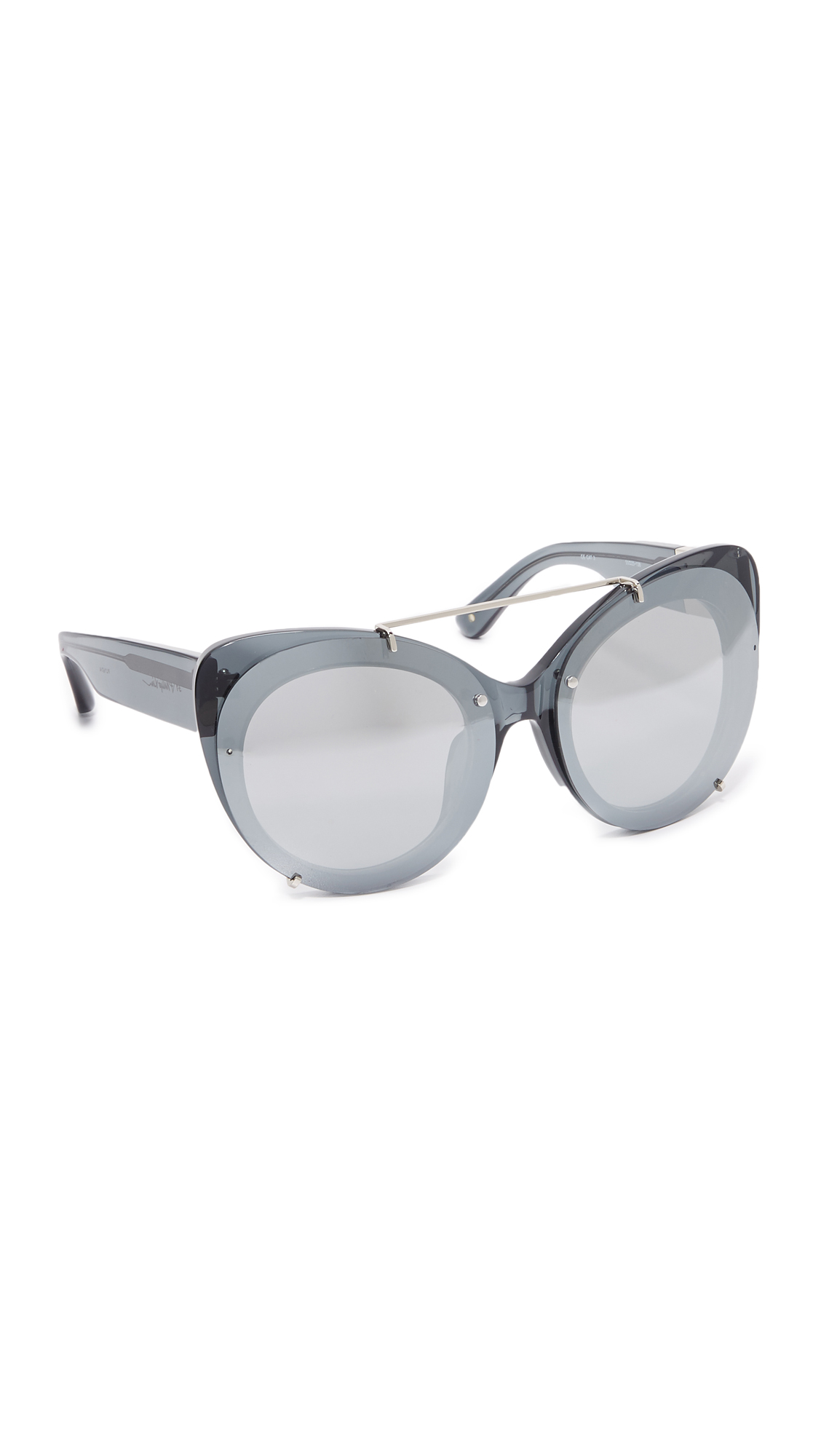 Oversized, cat eye 3.1 Phillip Lim sunglasses with raised, mirrored lenses. Soft pouch included. Cateye frame. Non polarized lenses. Imported, Japan. Measurements Width: 6in / 15.5cm Height: 2.25in / 6cm Lens Width: 55mm A manufacturer's warranty for this item