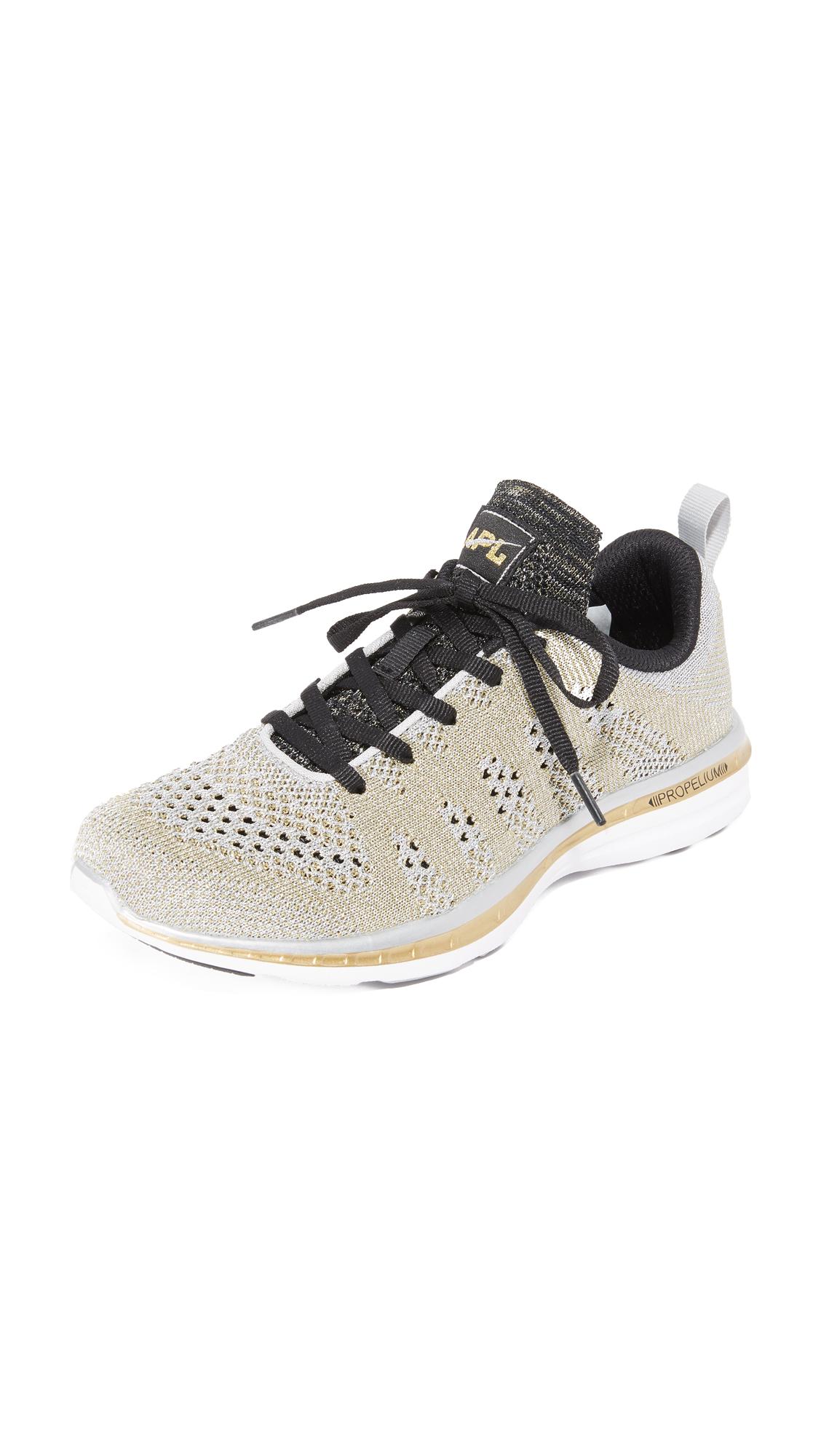 apl athletic propulsion labs female apl athletic propulsion labs techloom pro sneakers silvergoldblack