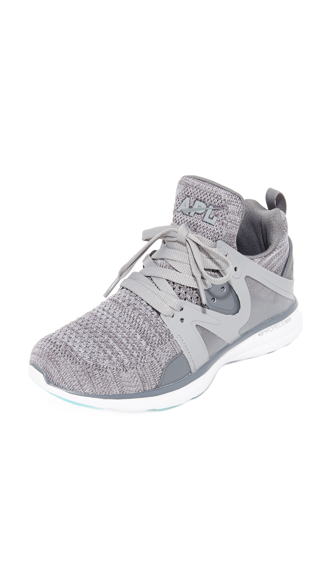 These APL: Athletic Propulsion Labs sneakers are made from heathered mesh and sculpted rubber panels. Padded top line and pull tab at the heel. Lace up closure. Foam platform and rubber sole. Fabric: Mesh. Imported, China.