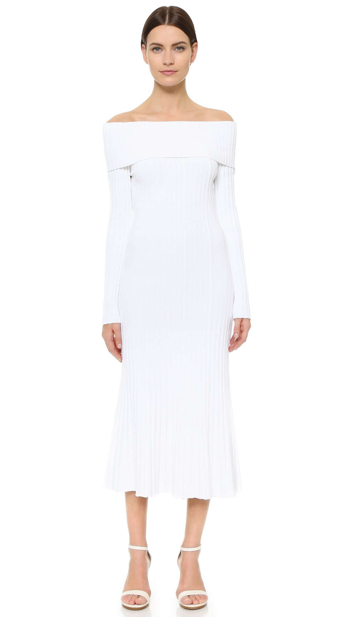 This ribbed Prabal Gurung sweater dress is fashioned with a chic fold over neckline. Slim silhouette with swingy skirt. Long sleeves. Unlined. Fabric: Slinky double knit. 75% viscose/25% polyamide. Dry clean. Imported, China. Measurements Length: 42.25in / 107cm,