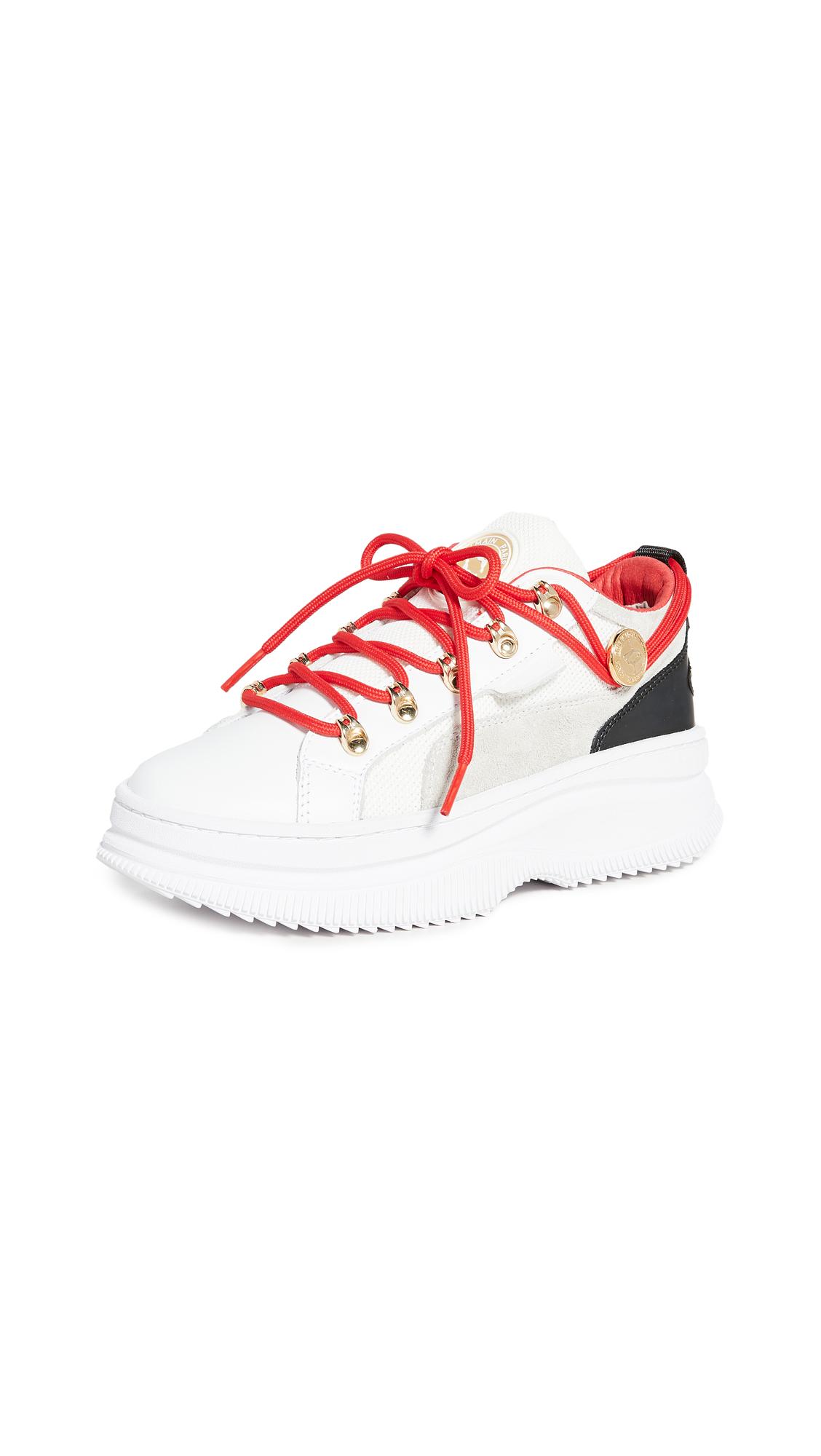Buy PUMA online - photo of PUMA x Balmain Deva Low Sneakers