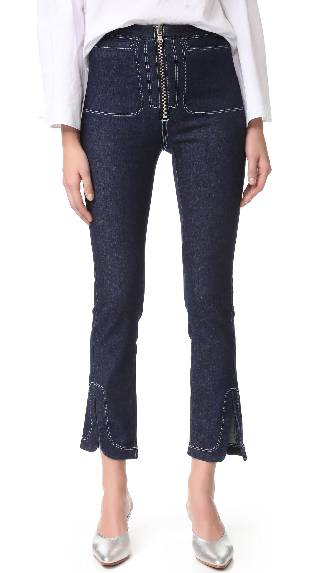 These lightweight, high waisted Rachel Comey jeans are finished with clean, contrast stitching. Welt hip pockets. Exposed zip closure. Vented hems. Fabric: Stretch denim. 89% cotton/8% polyester/3% spandex. Wash warm. Made in the USA. Measurements Rise: 11.25in / 28.5