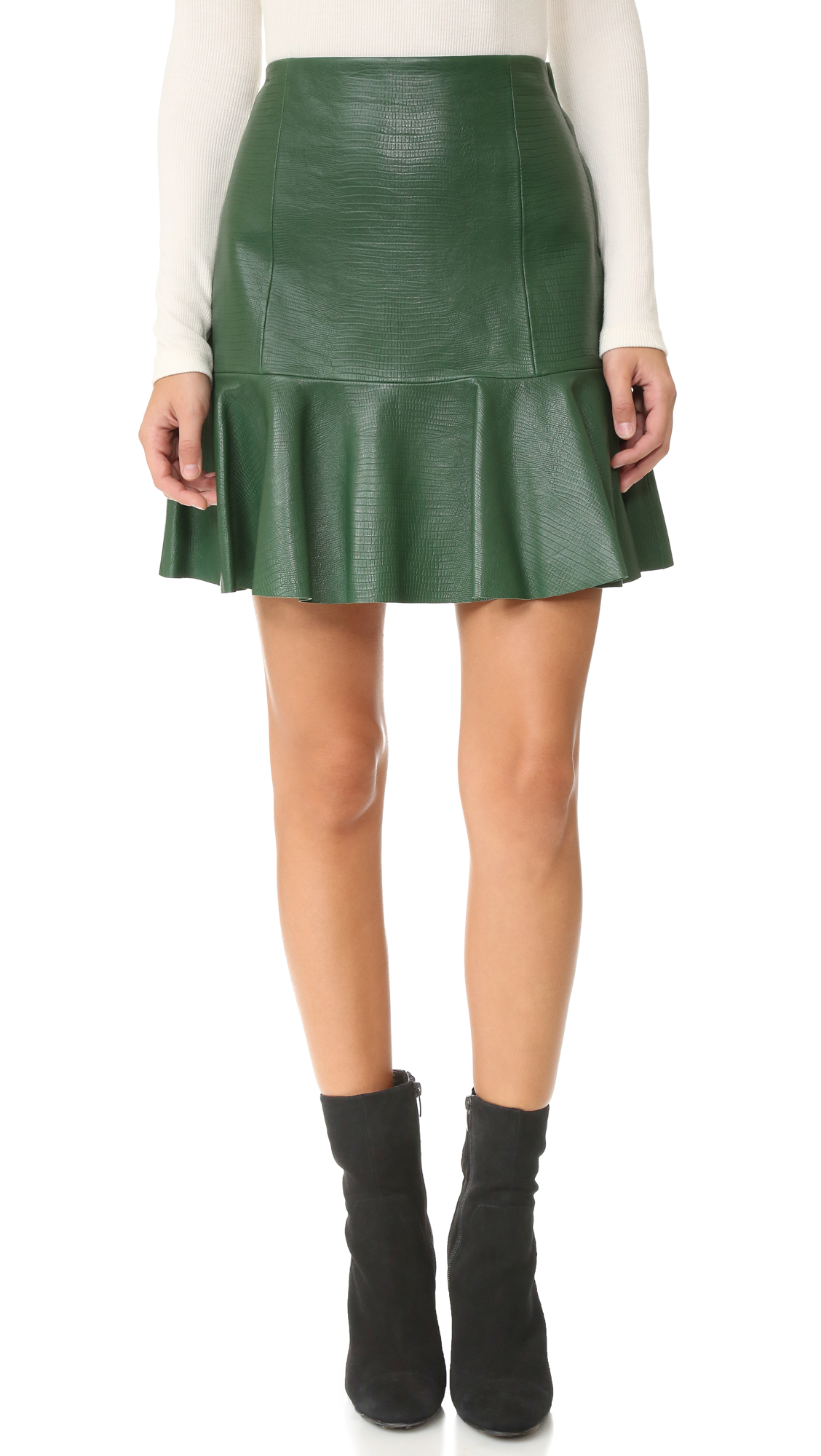 Embossed reptile scales bring exotic edge to this leather Rebecca Taylor miniskirt. The flounced, laser cut hem adds a flirty finish. Side zip. Lined. Fabric: Embossed leather. Shell: 100% lambskin. Lining: 100% polyester. Leather clean. Imported, China. Measurements