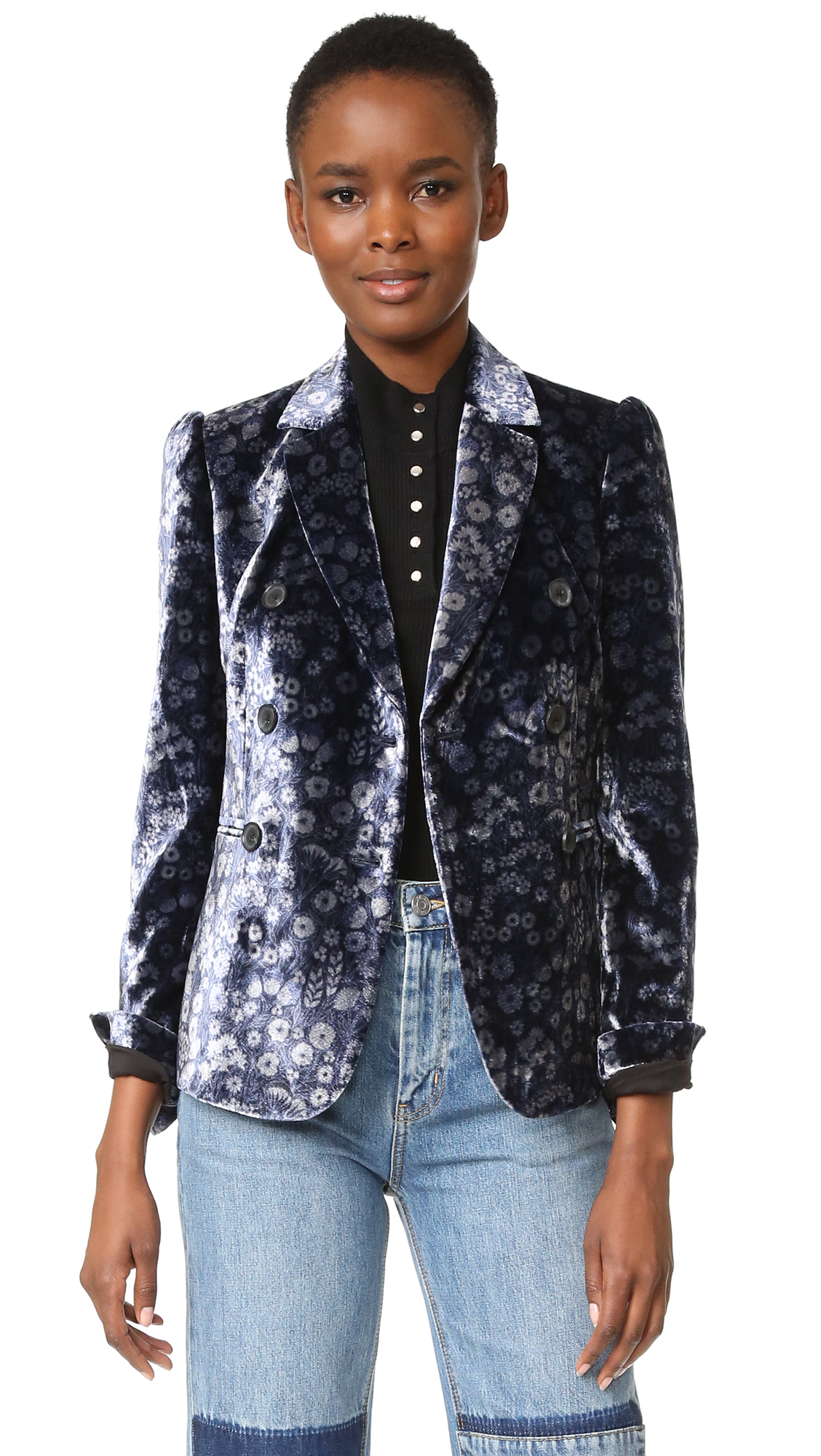 This velvet Rebecca Taylor double breasted blazer is detailed with an allover floral print. Notched lapels and button placket. Welt front pockets. Padded shoulders. Button cuffs. Lined. Fabric: Crushed velvet. Shell: 82% rayon/18% silk. Trim: 100% polyester. Lining: 57%