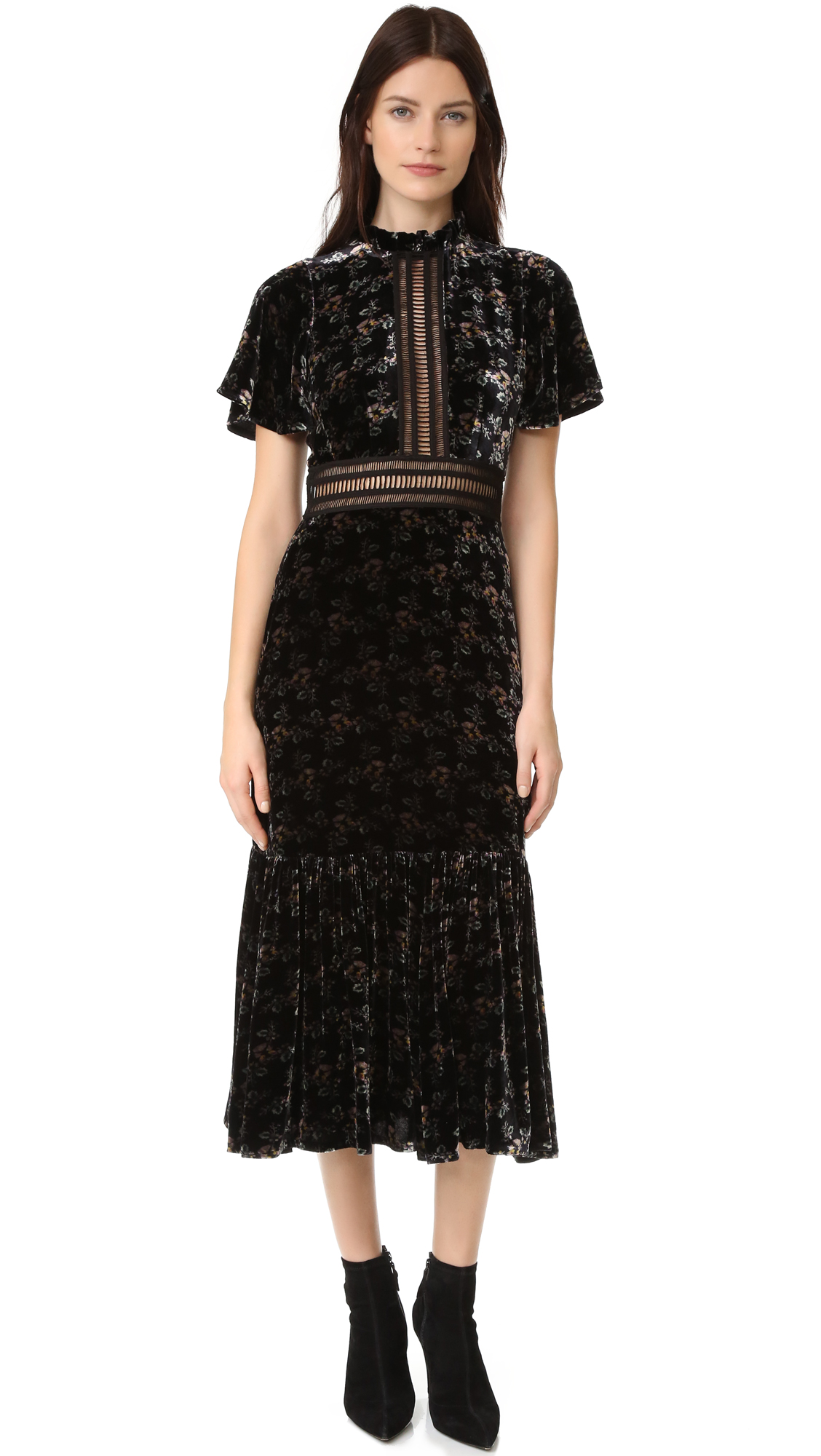 Floral velvet gives this Rebecca Taylor dress a feminine, luxe aesthetic. Sheer, embroidered panels reveal peeks of skin at the bodice and waist. Flounced hem. Short sleeves. Hidden back zip. Lined. Fabric: Velvet. Shell: 64% viscose/36% silk.
