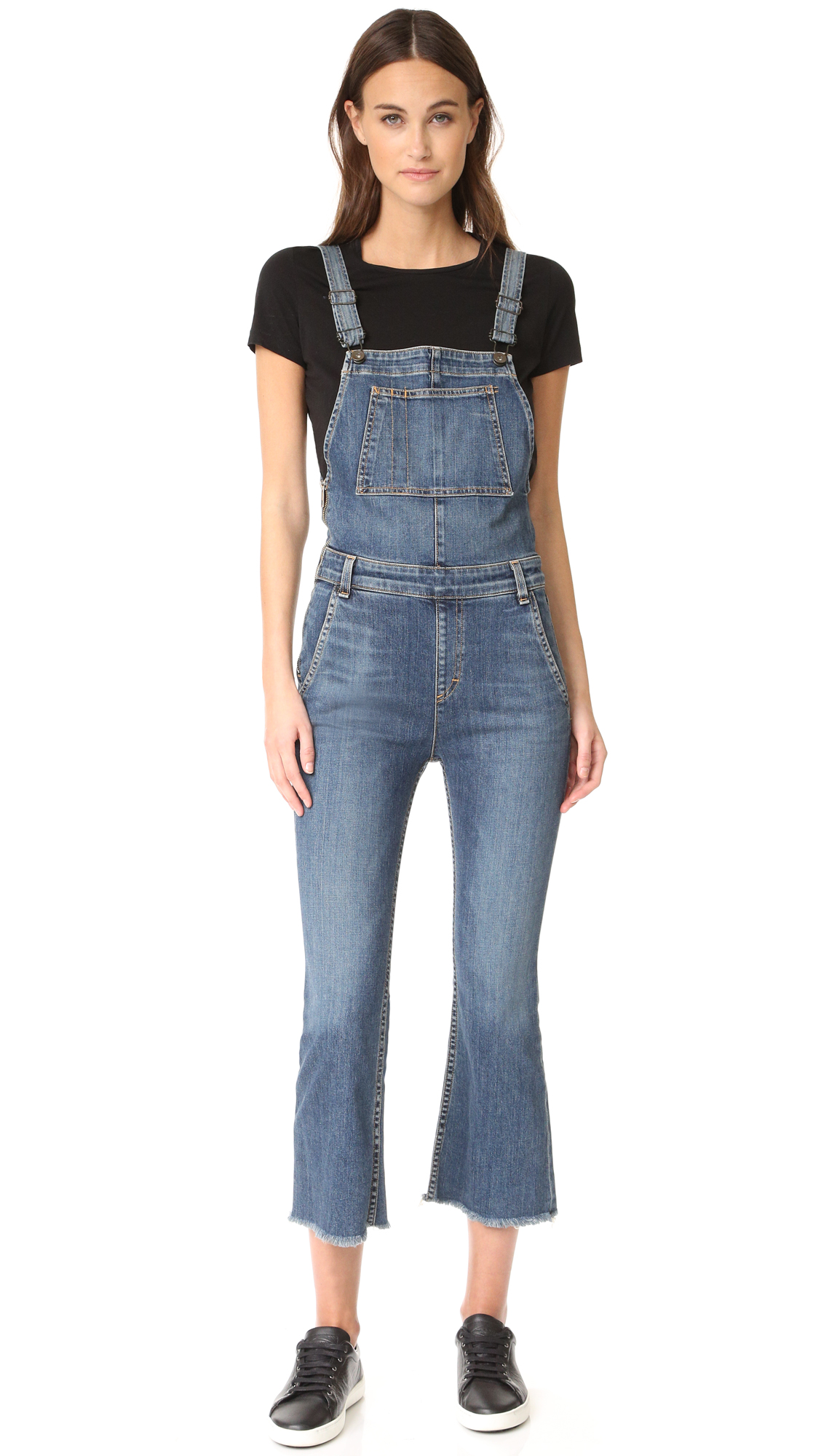 Rag & Bone/JEAN overalls in a classic cut. Exposed side zip. Patch bib pocket, slant side pockets, and patch back pockets. Adjustable shoulder straps. Raw hems at the flared leg openings. Fabric: Stretch denim. 98% cotton/2% polyurethane.