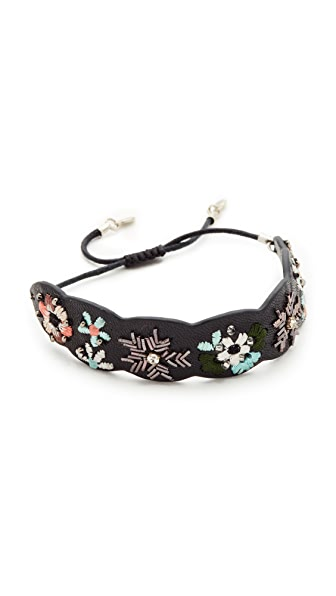 Rebecca Minkoff Floral Embroidery Guitar Strap Bracelet In Black