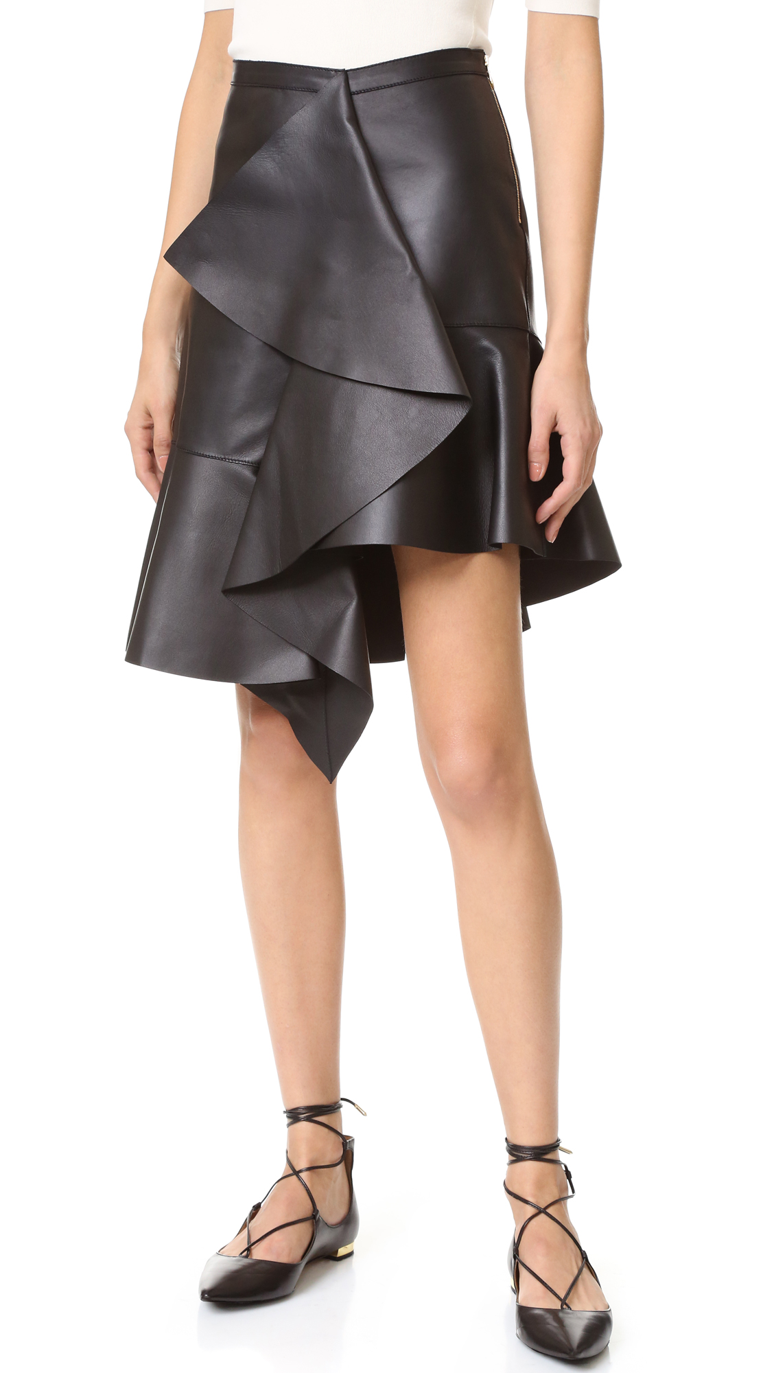 Cascading ruffles lend a charming touch to this supple leather Rochas skirt. Exposed side zip. Unlined. Fabric: Leather. 100% lambskin. Leather clean. Made in Italy. Measurements Length 1: 19.75in / 50cm, to shortest point Length 2: 22.5in / 57cm, to longest