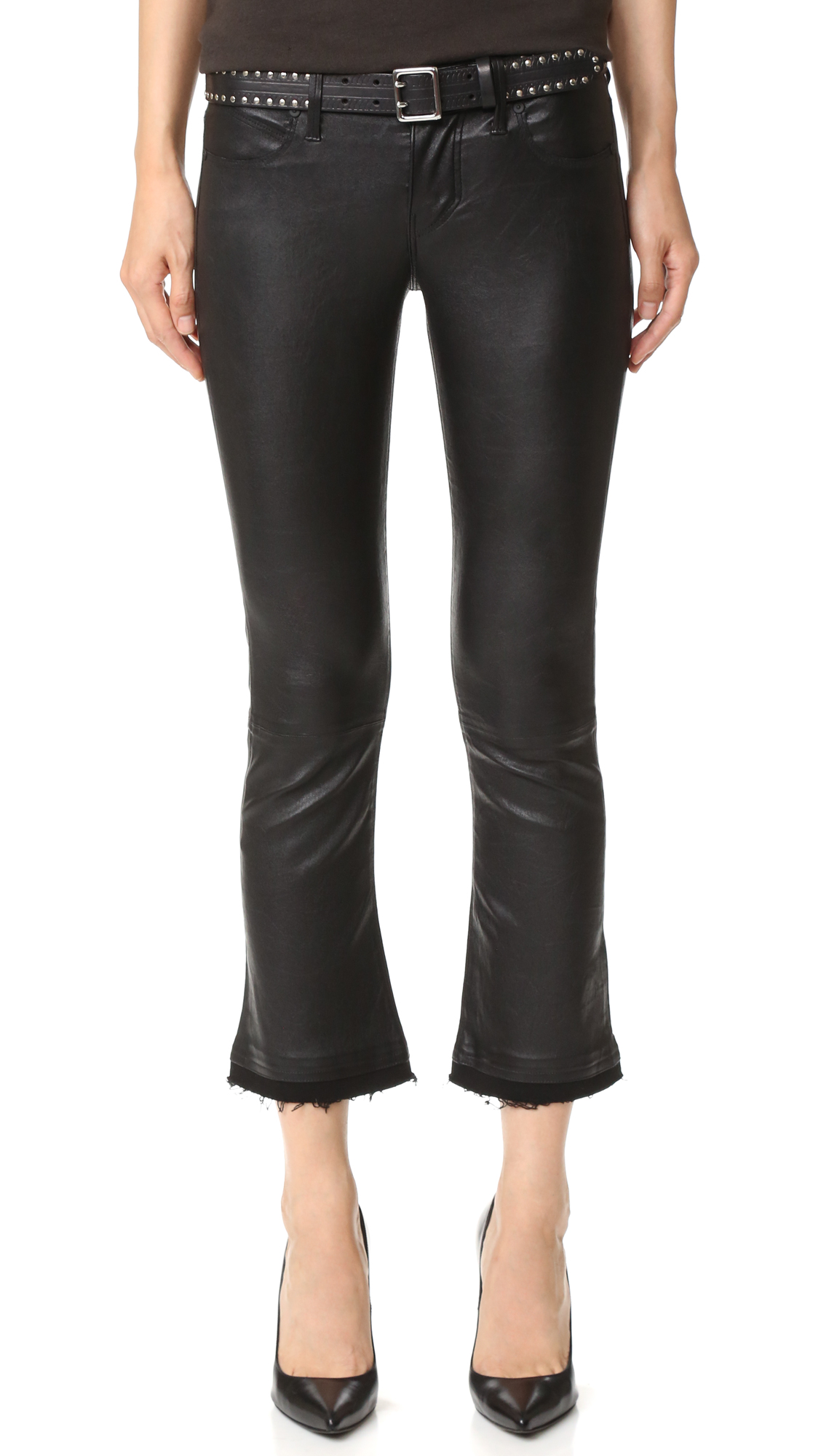 These RtA leather pants are updated with edgy, shredded denim trim at the cuffs. Slant hip pockets and patch back pockets. Single button closure and zip fly. Lined. Fabric: Leather. Shell: 100% lambskin. Trim: 98% cotton/2% polyurethane. Leather