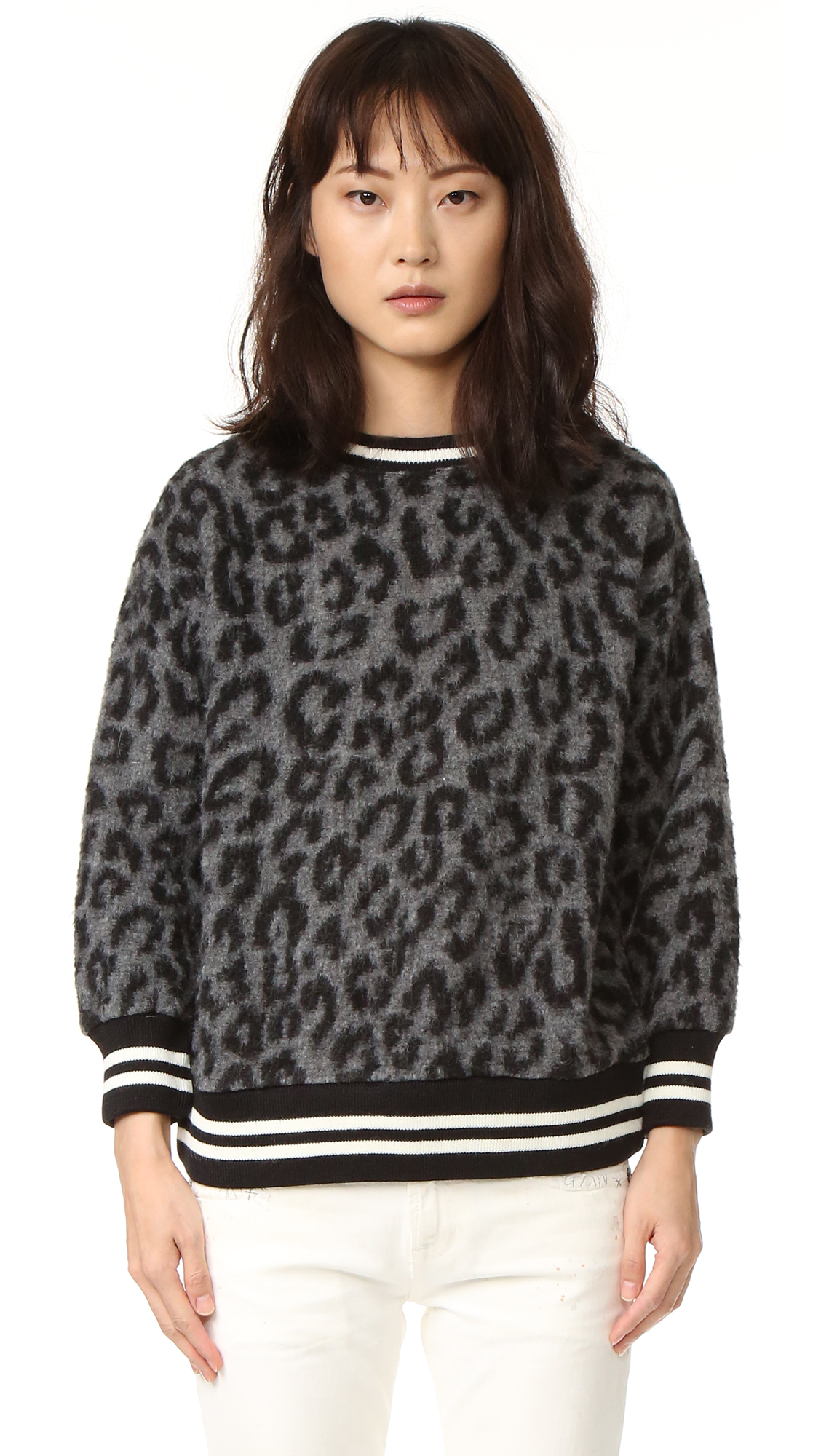 A leopard print motif details this fuzzy R13 sweater. Striped, ribbed edges add a sporty finish. Fabric: Brushed knit. Shell: 64% polyester/36% wool. Trim: 70% acrylic/30% wool. Dry clean. Imported, China. Measurements Length: 24.5in / 62cm, from shoulder Measurements