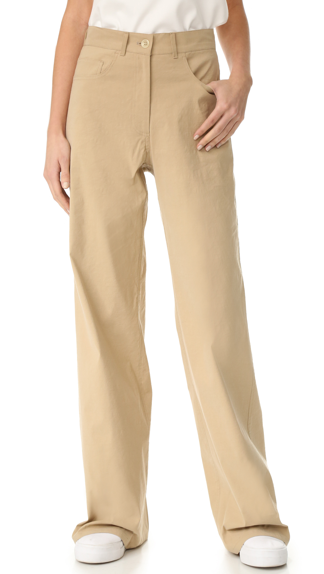 Crisp Sea pants in a high waisted, wide leg profile. 5 pocket styling. Button closure and zip fly. Fabric: Twil. 45% viscose/30% linen/20% cotton/5% elastane. Dry clean. Made in the USA. Measurements Rise: 11.75in / 30cm Inseam: 34.75in / 88cm