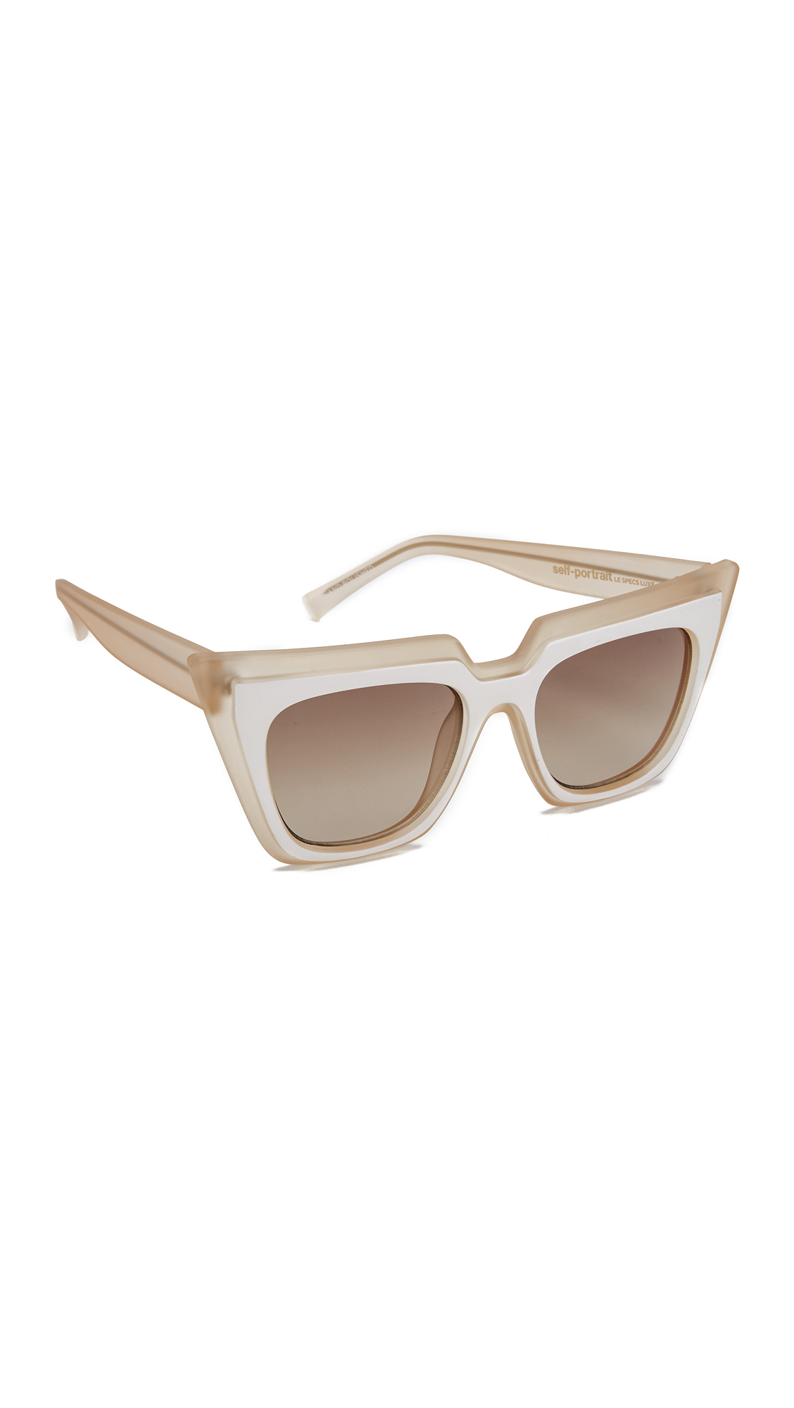 A collaboration between Self Portrait and Le Specs. The dramatic cat eye frames of these Self Portrait sunglasses create a bold stylish look. Frosted frames and matte overlay. Gradient lenses. Case and drawstring bag included. Cateye